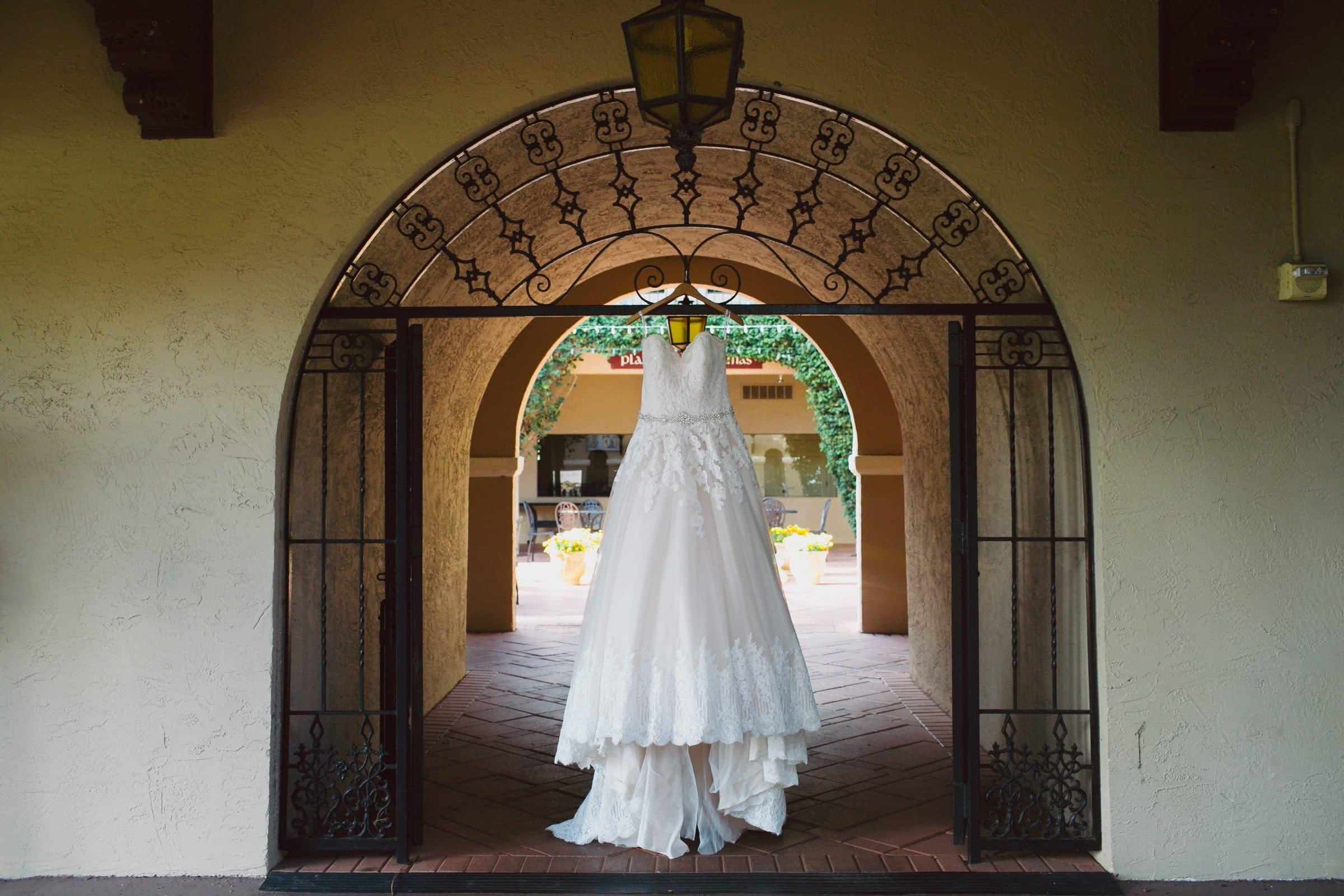 Dress Hanging on Iron Gate