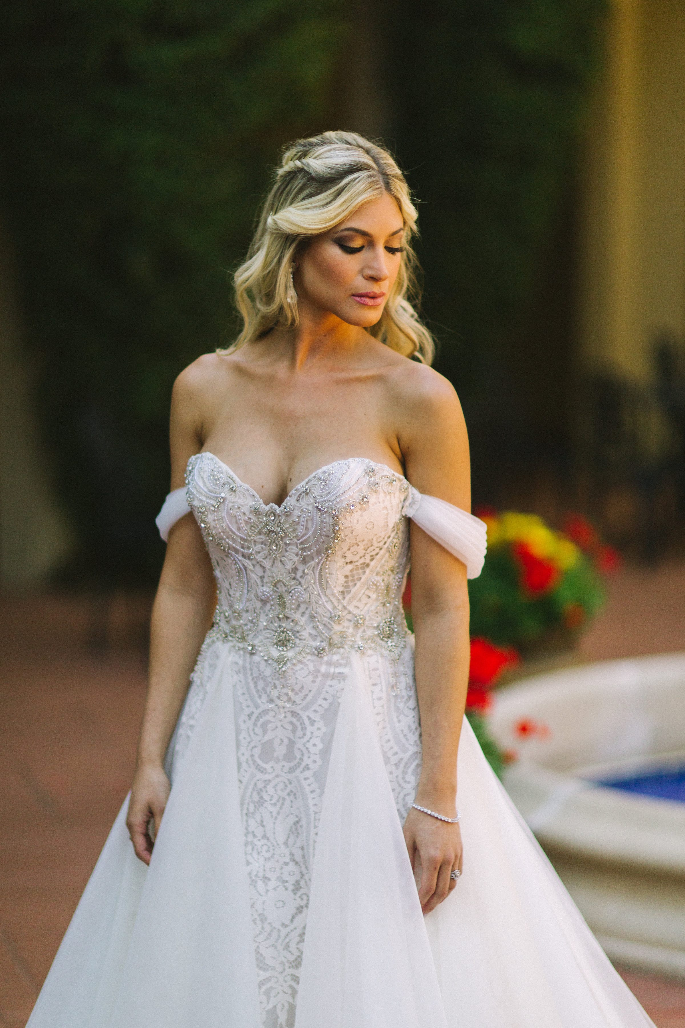 Bride in wedding dress with hanging straps