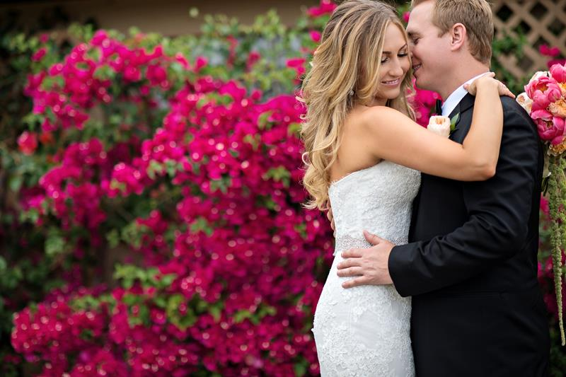 Bride and Groom in front of Hot Pink Bouganvilla