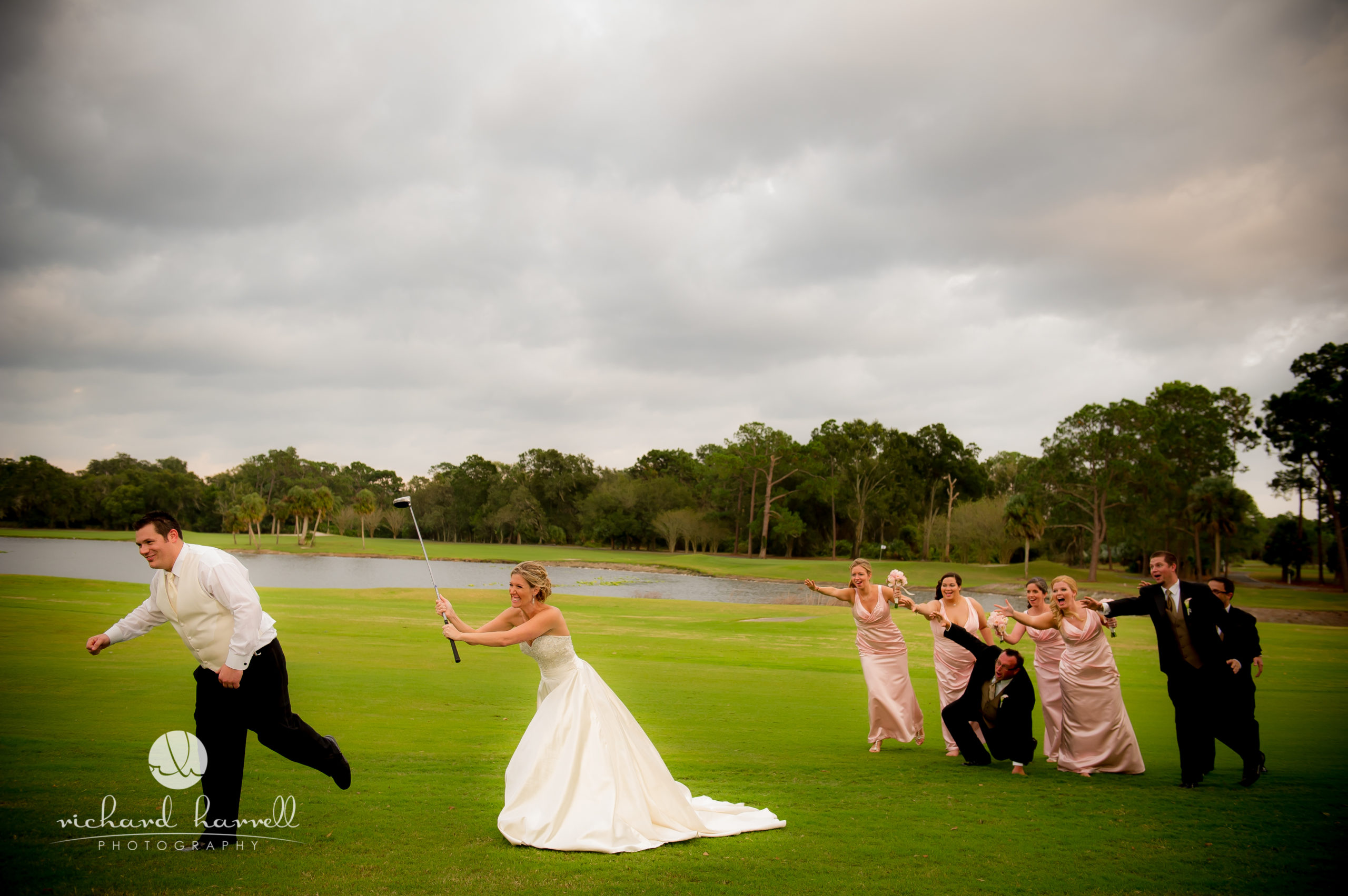 Bride chasing groom with golf club on golf course