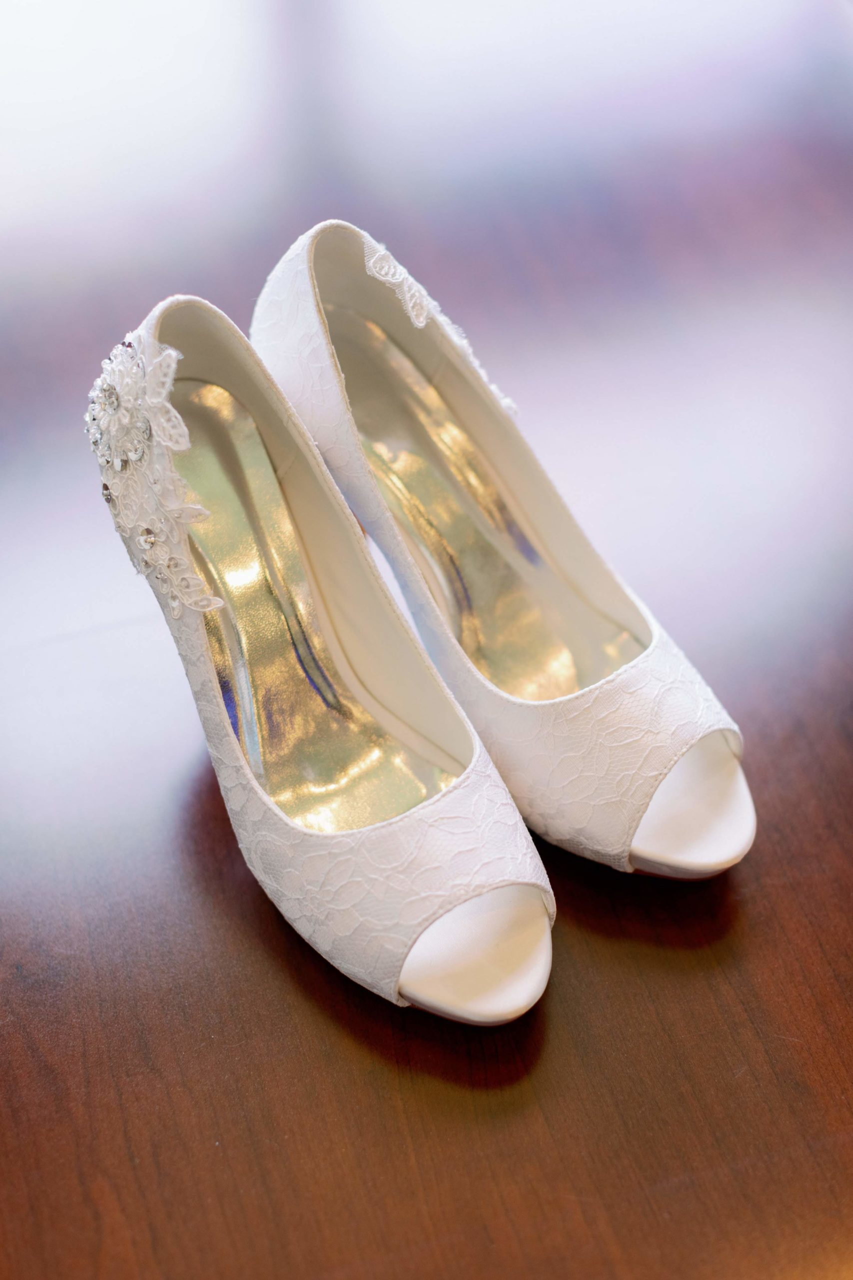 pair of white high heeled wedding shoes