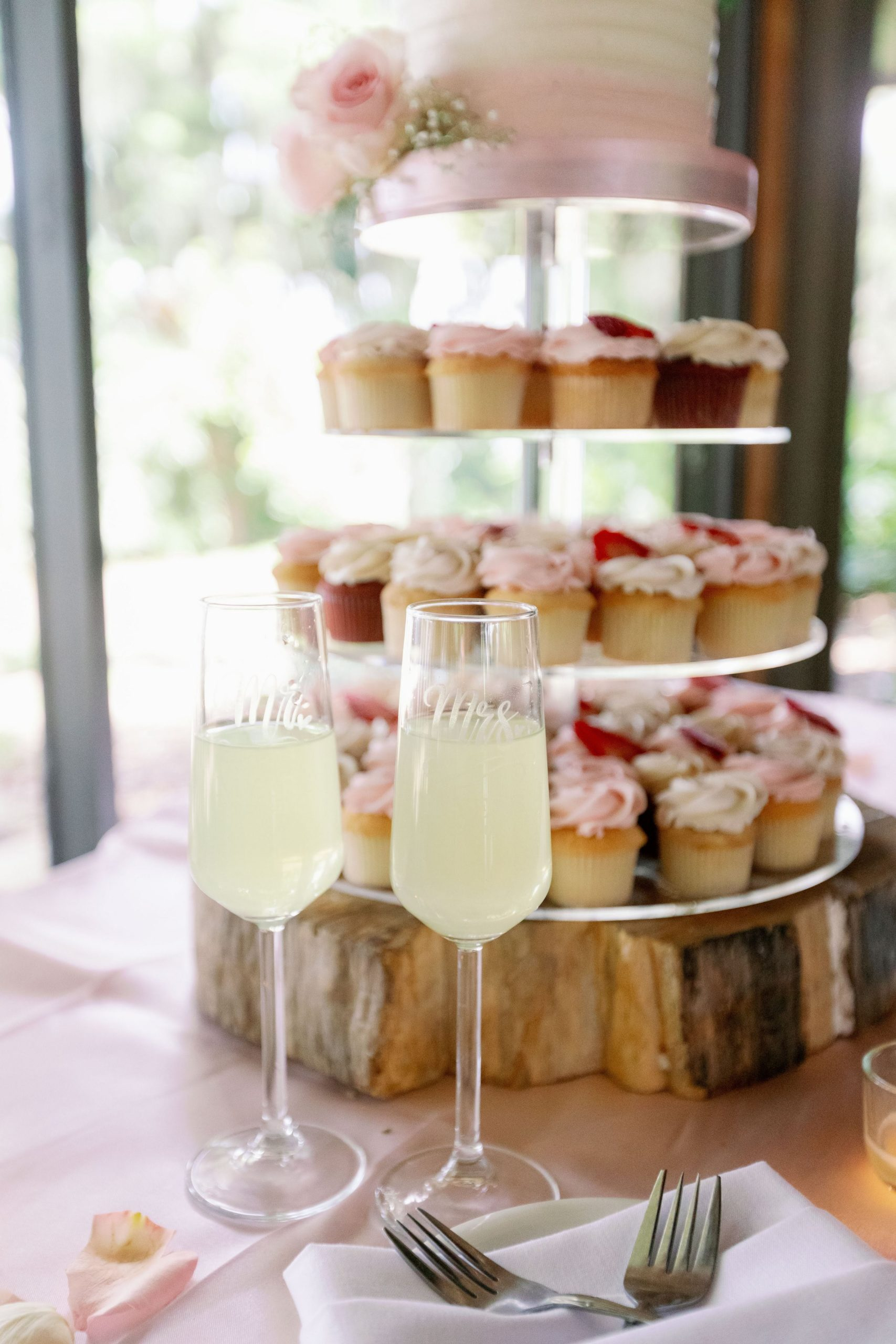 cupcake display with two glasses of mimosas