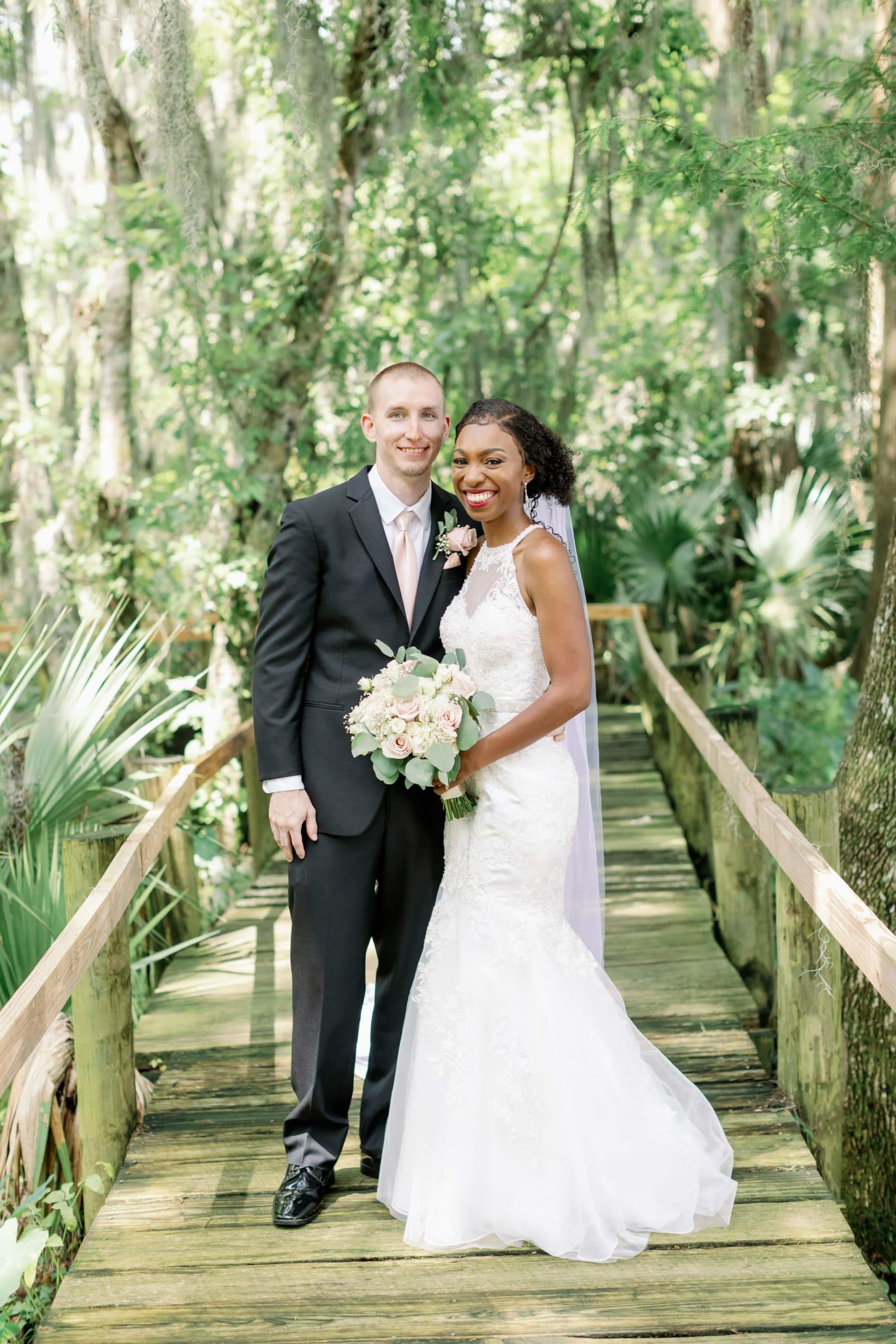 Bride and Groom on Wooden Lakeside Boardwalk for Brunch Wedding