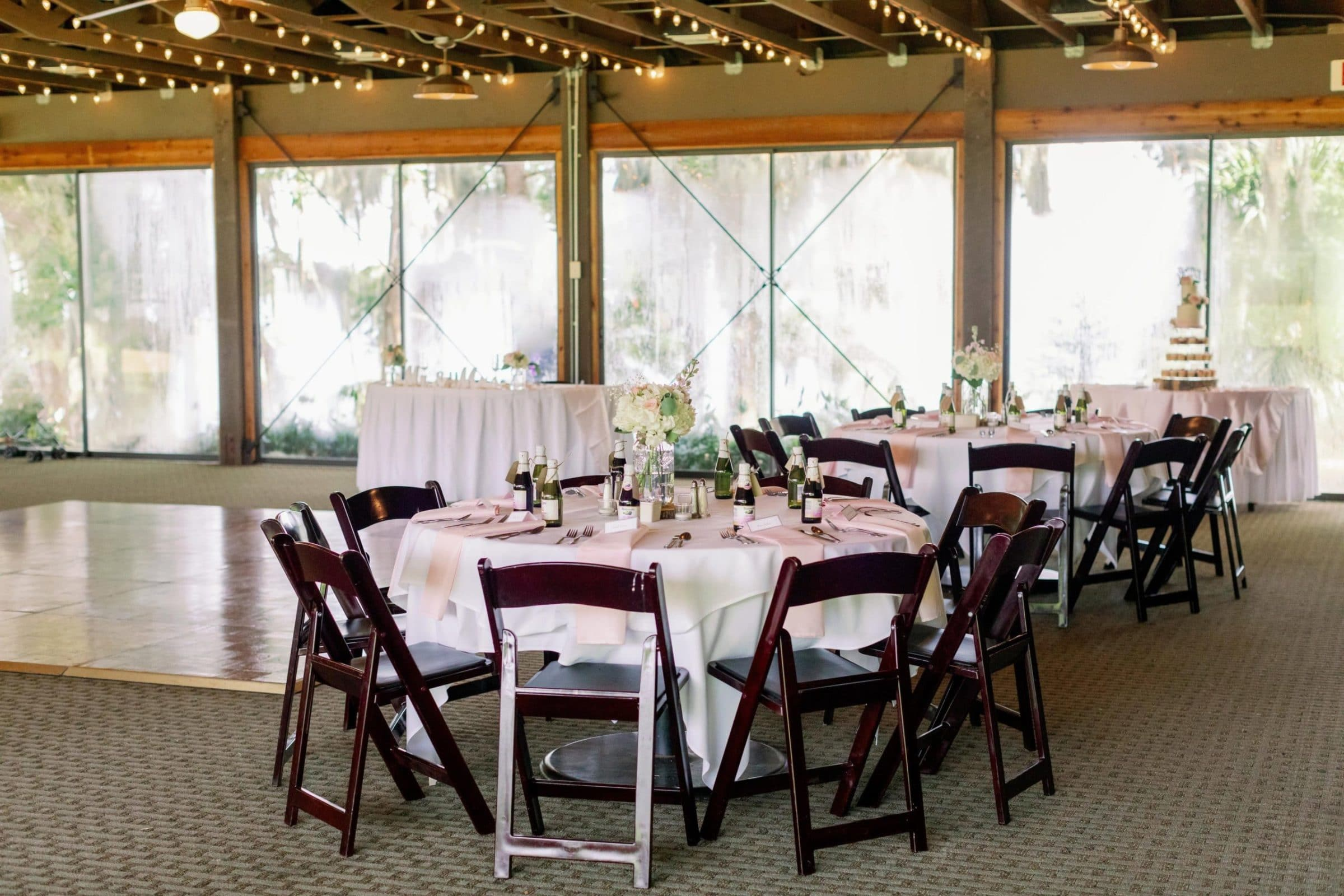 Lakeside Brunch Wedding Reception Venue with White Linen tables with Pink Napkins