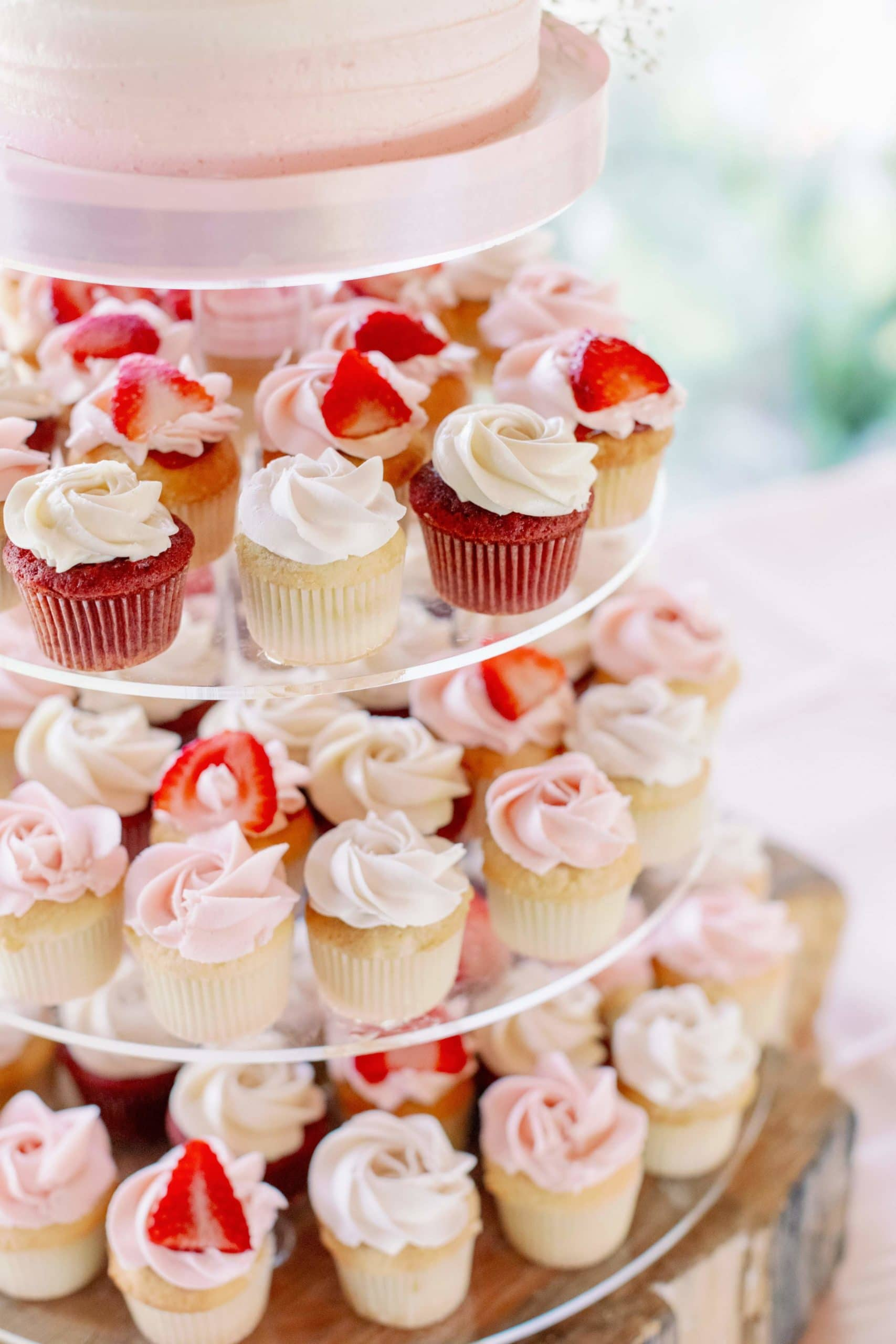 assorted pink and white wedding cupcakes