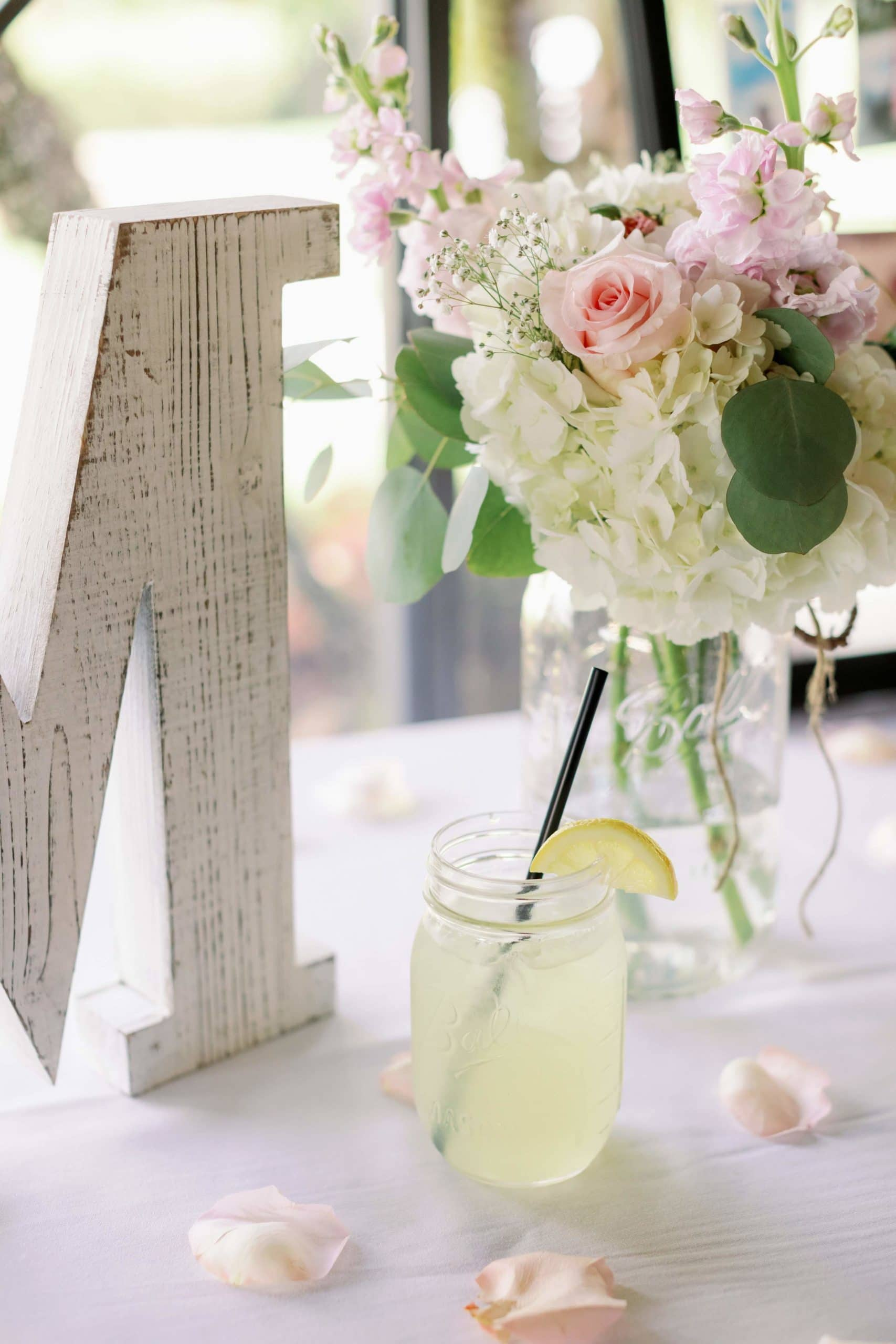 Grey M with mimosa and flowers from wedding