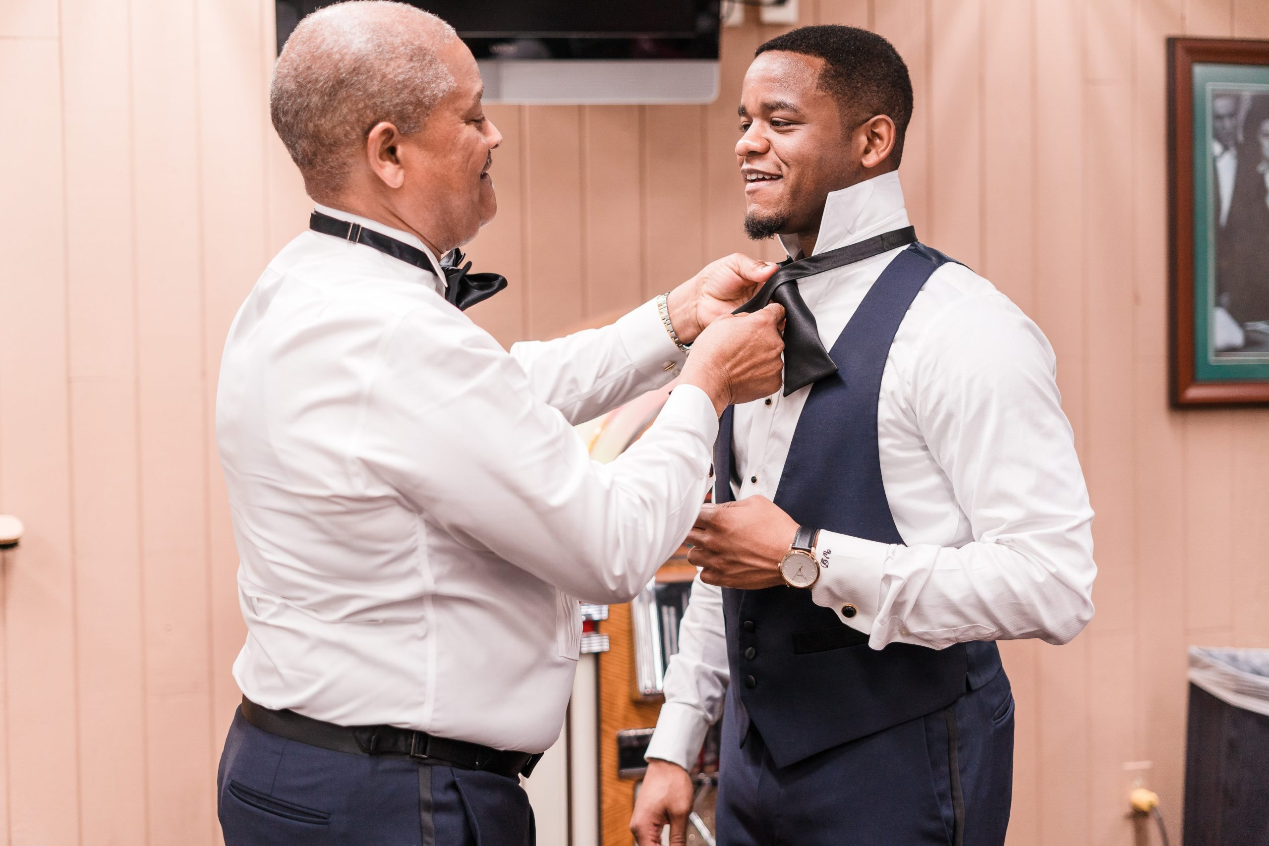 Adjusting the grooms bowtie