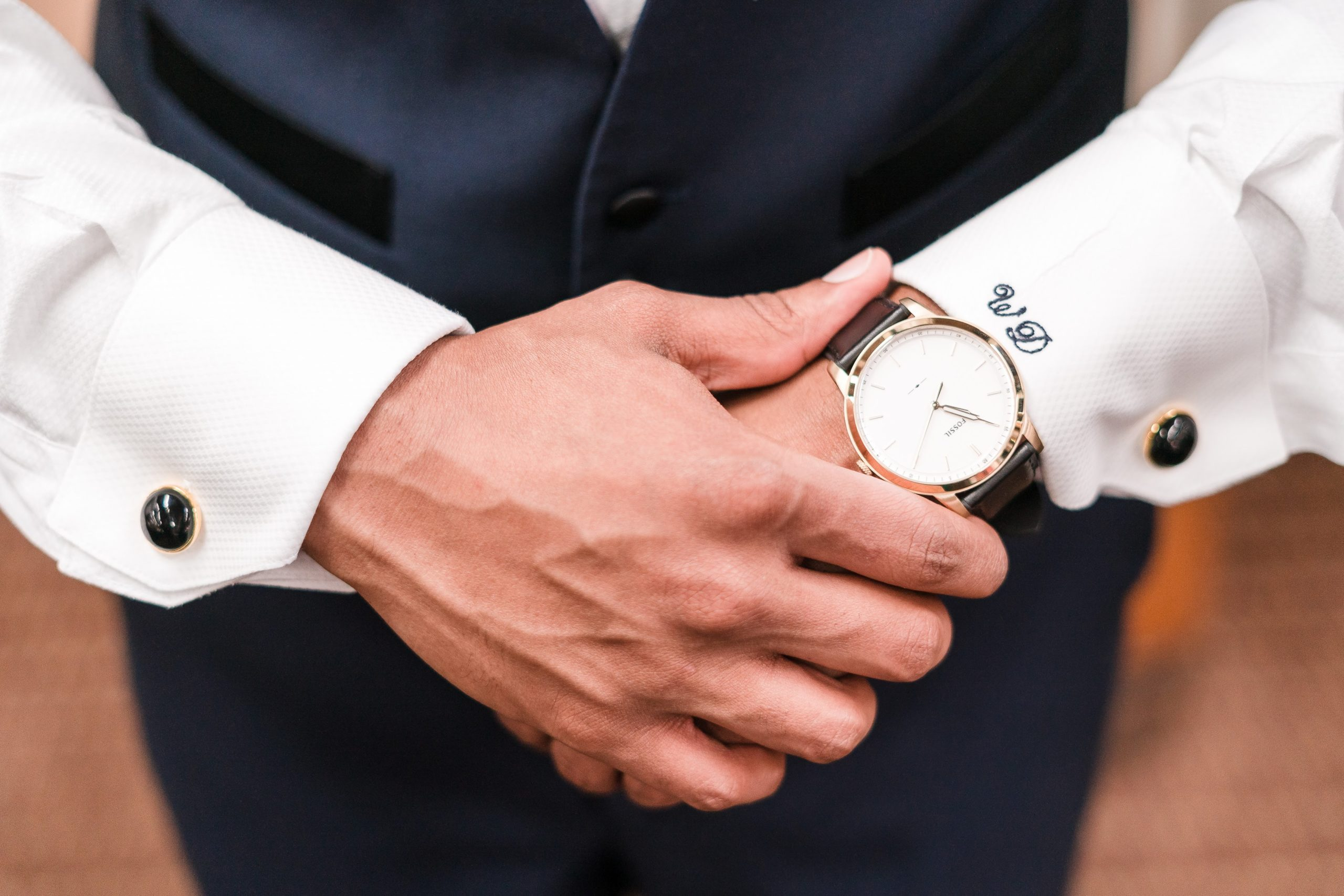 groom holding hands together showing off new watch