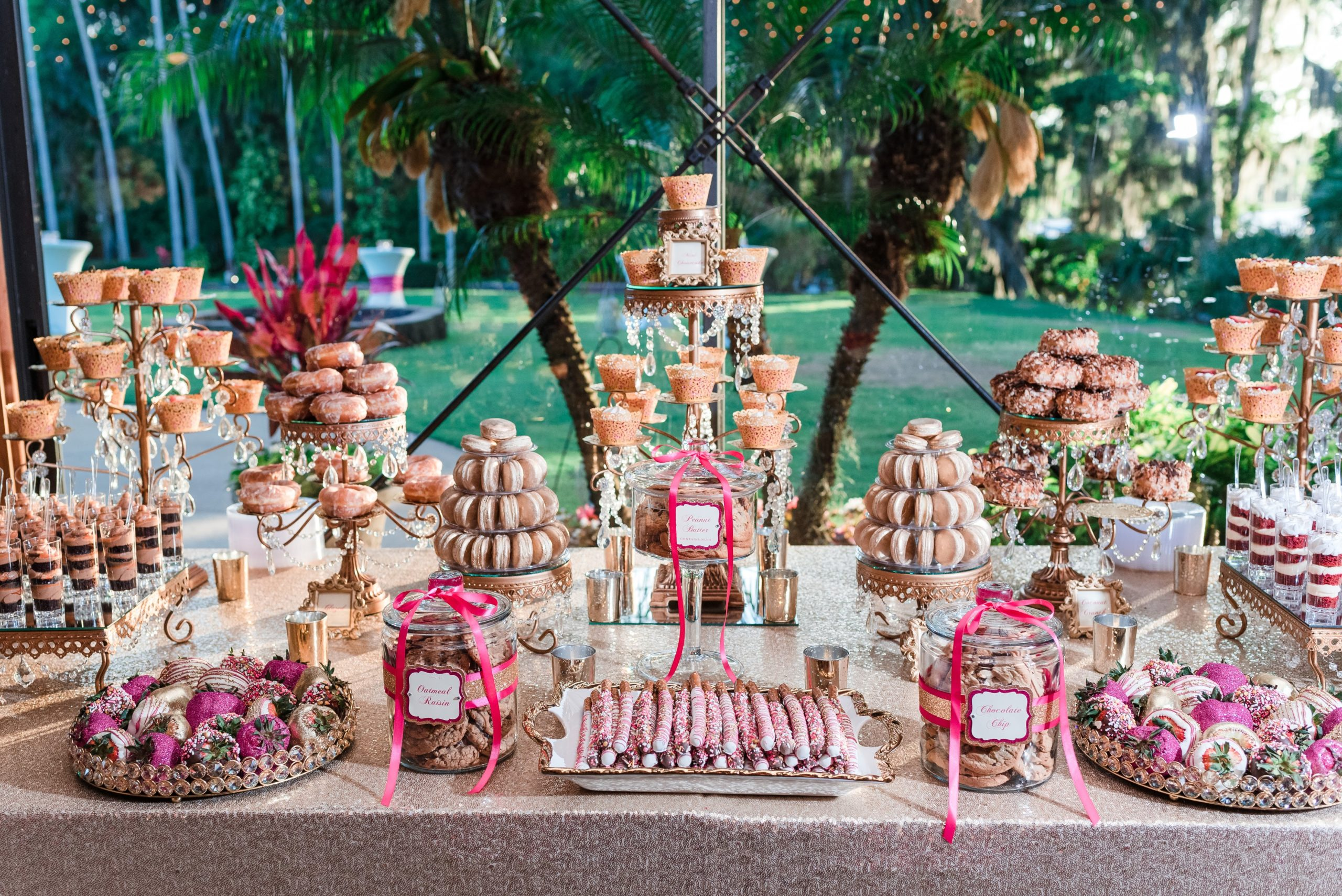 fun pink candy bar and dessert display in glass jars