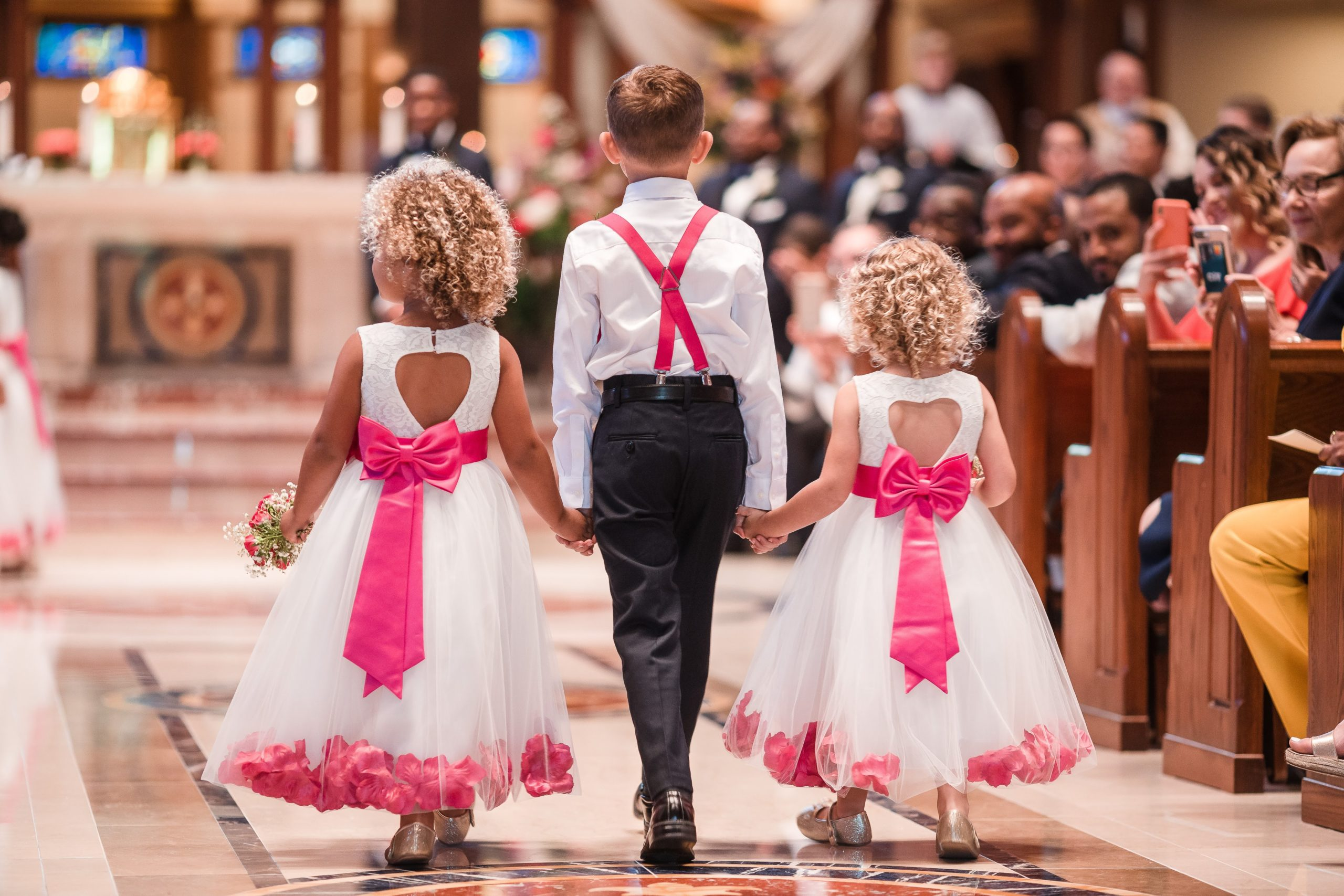 flower girls and ring bearer in white and pink