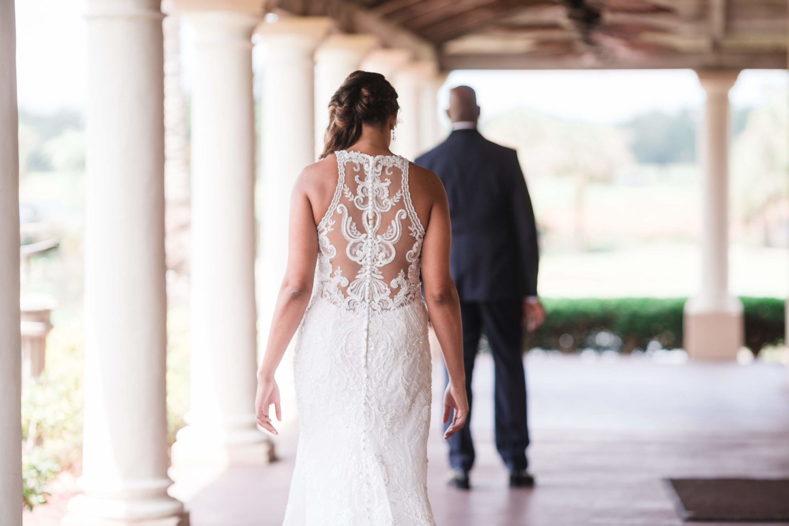 back of bride as she walks up to her dad