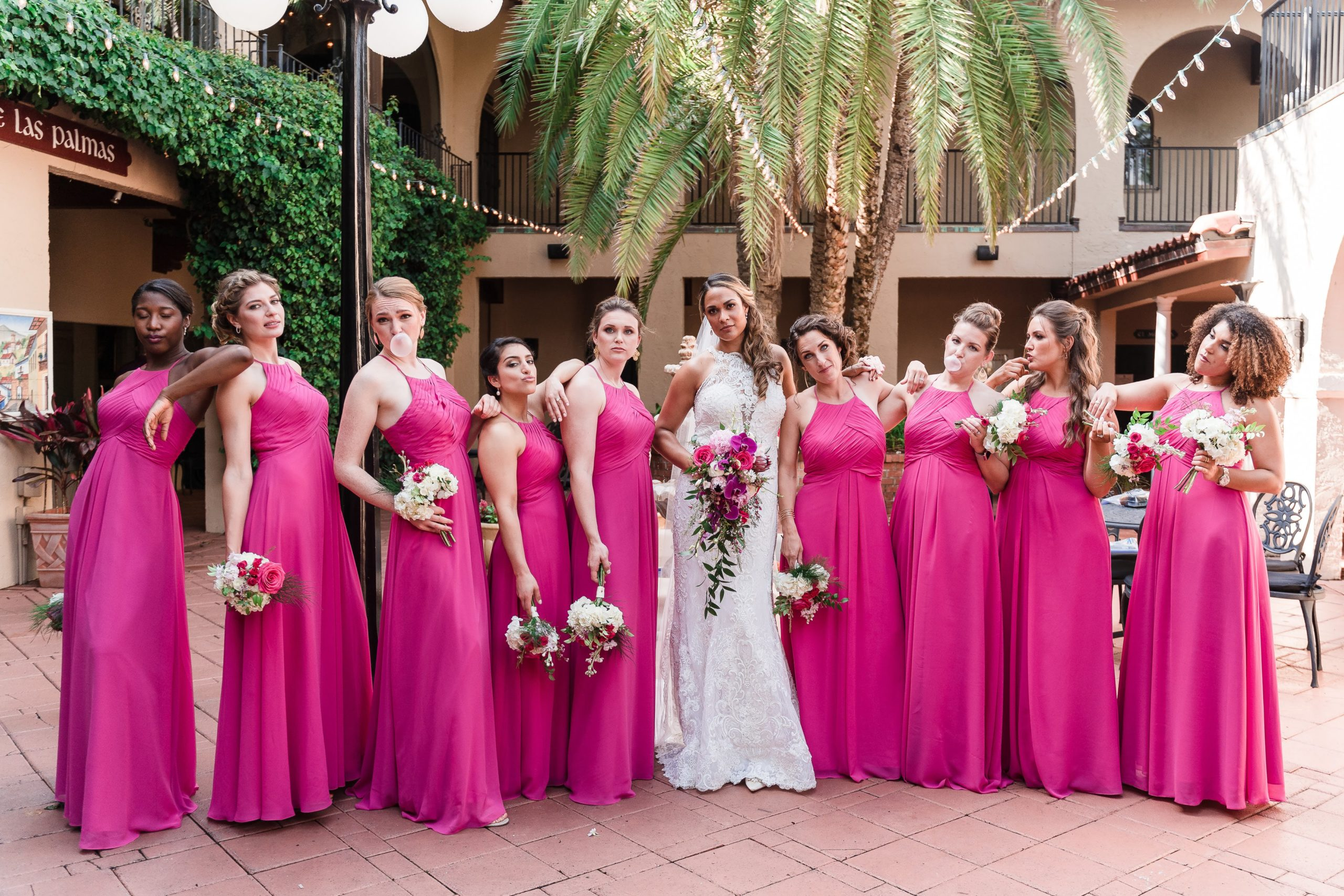 bridal party standing together in pink gowns with bride