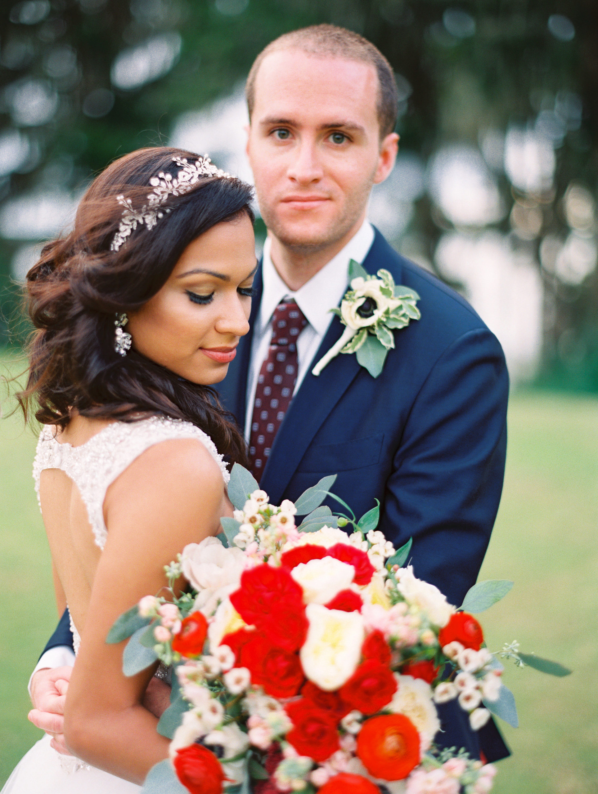 Bride holding beautiful bouquet with groom