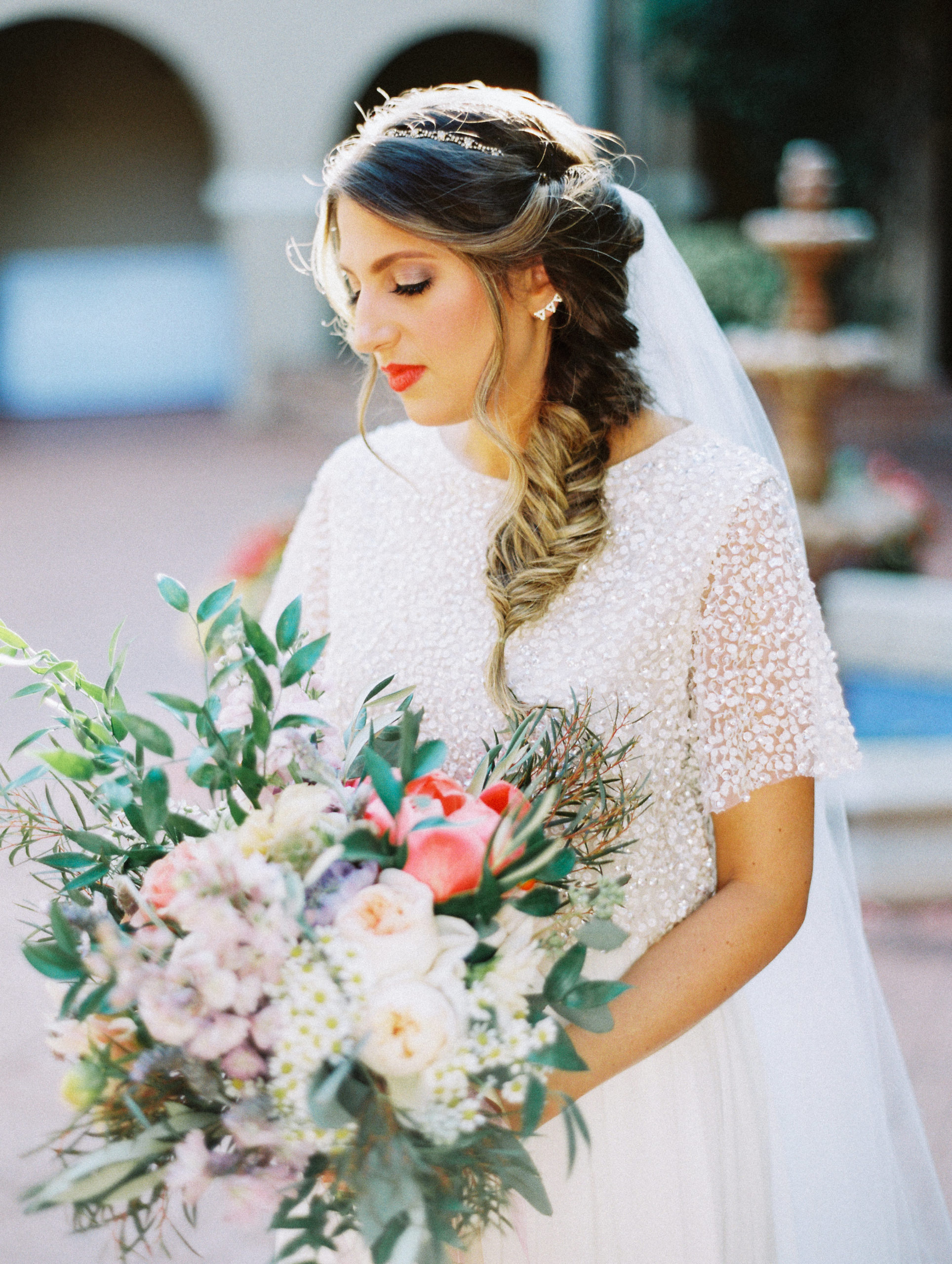 bride showcasing her flowers and bridal hair styles