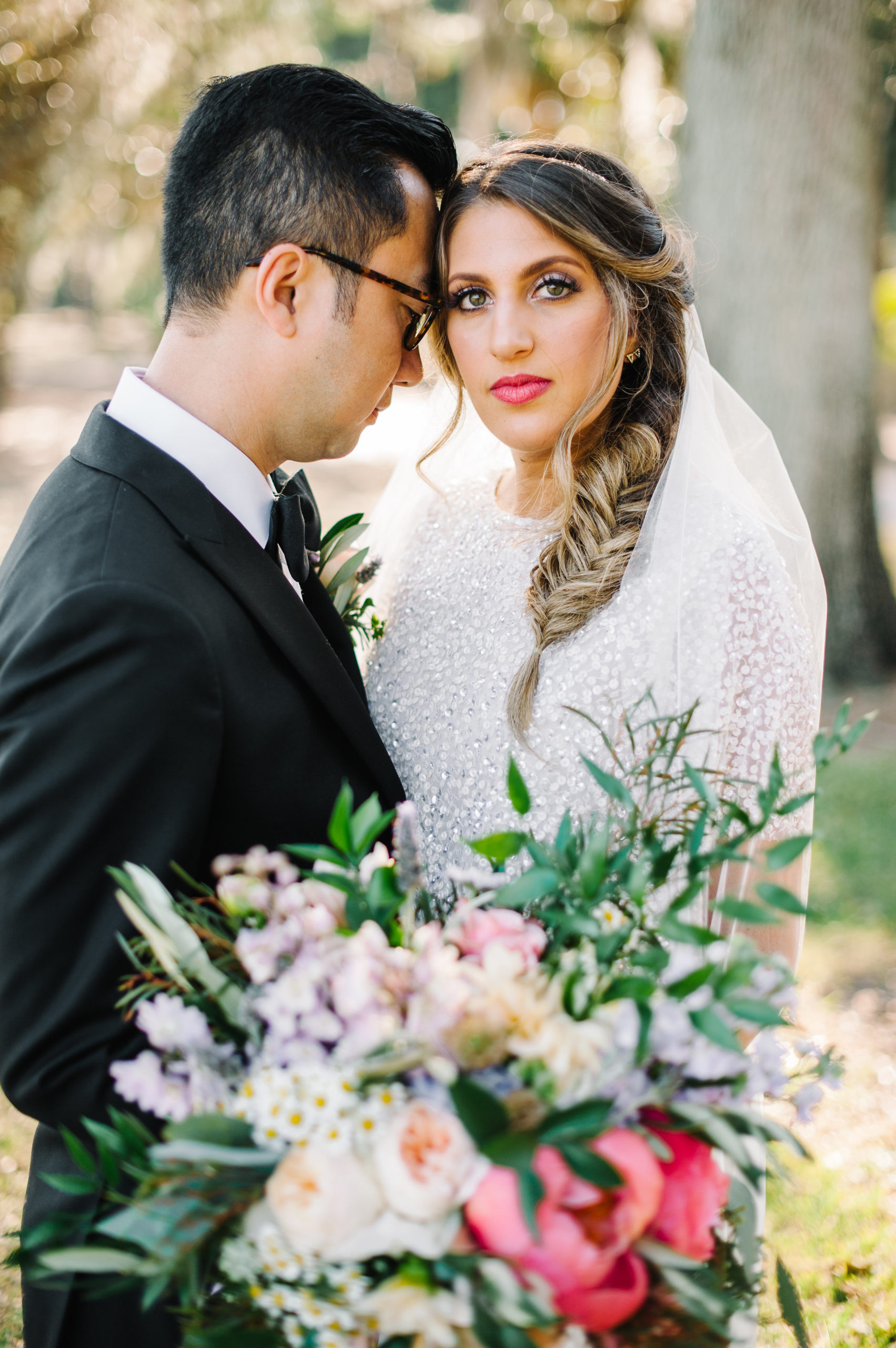 bride and groom with gorgeous flowers