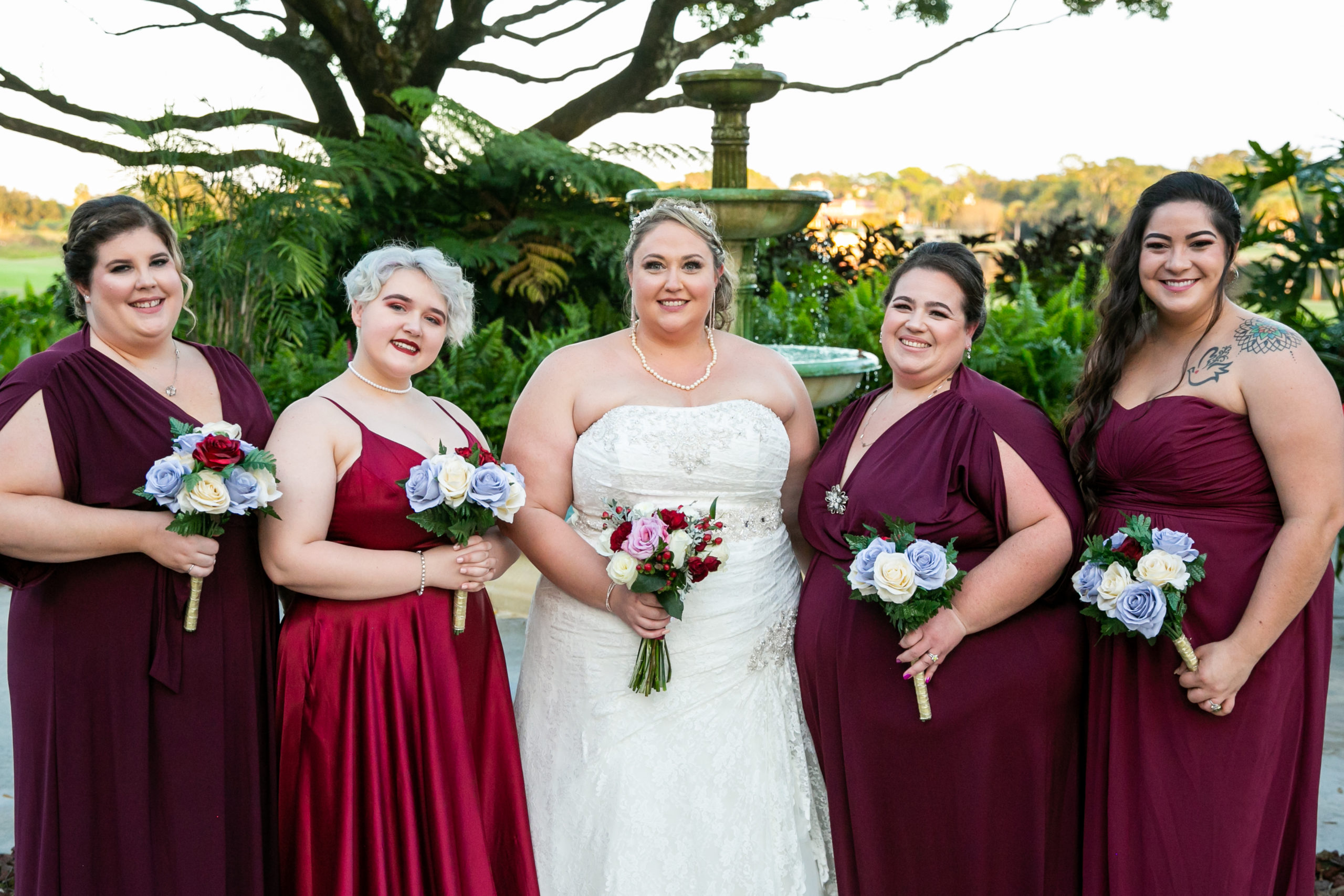 Bridal party in Burgundy for Vineyard Inspired Wedding
