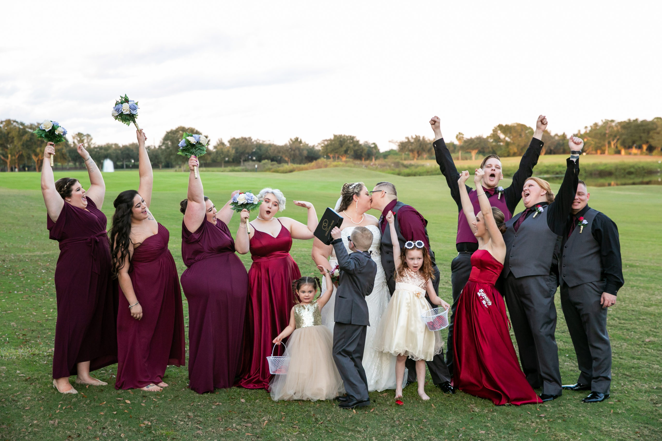 Fun bridal party picture with bridal party in burgundy for vineyard inspired wedding