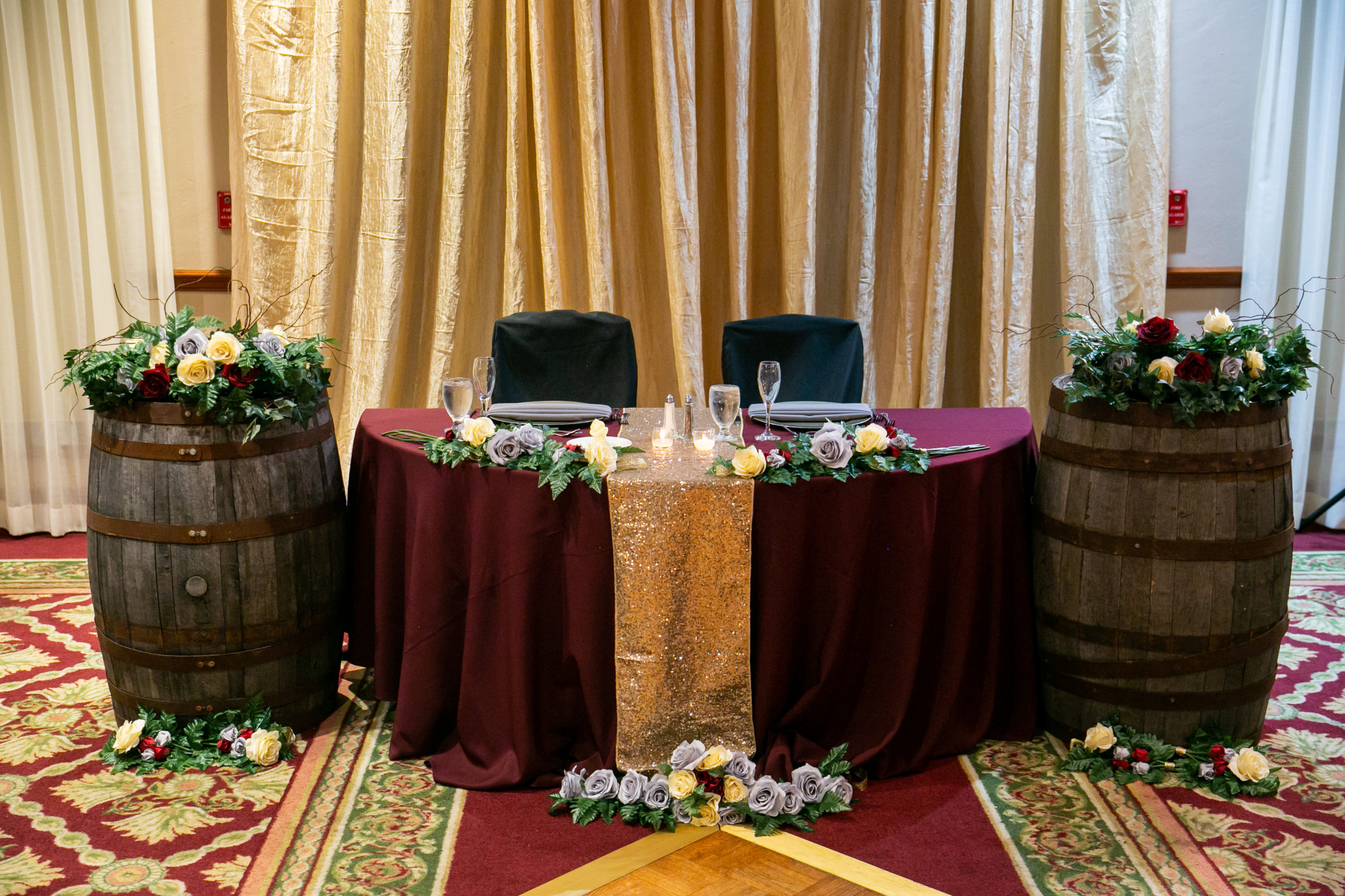 Vineyard Inspired Wedding Sweetheart Table With Slate, Burgundy and Gold