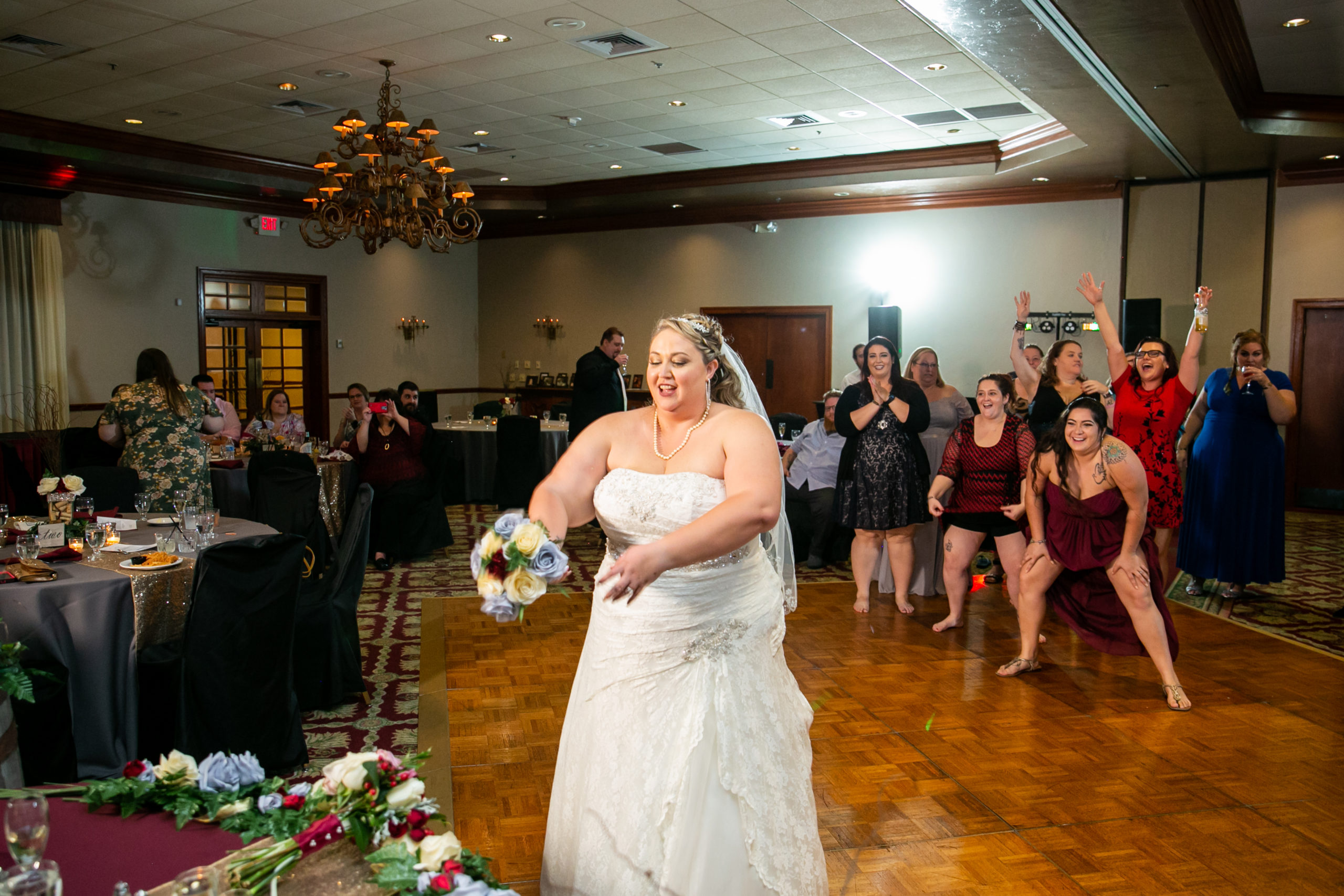 bride tossing her bouquet to her bridesmaids