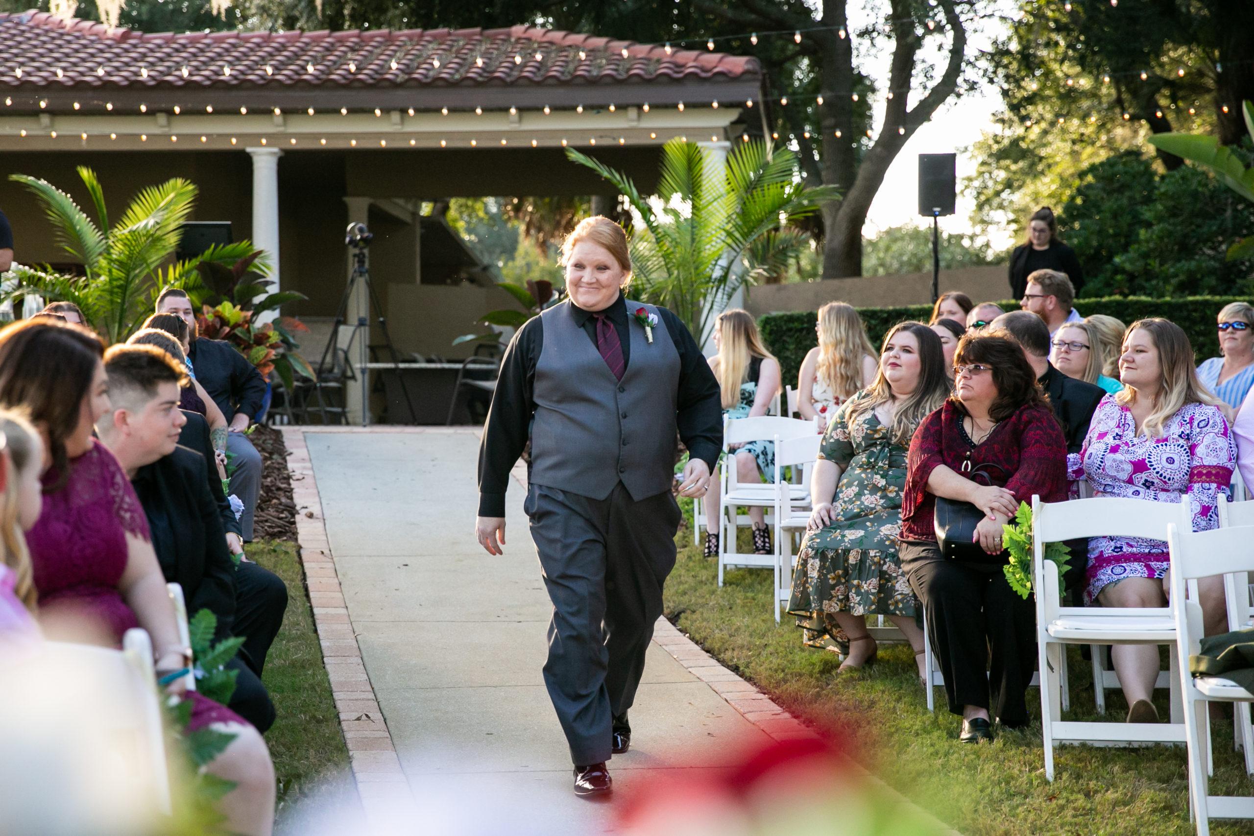 sister of bride walking down the aisle