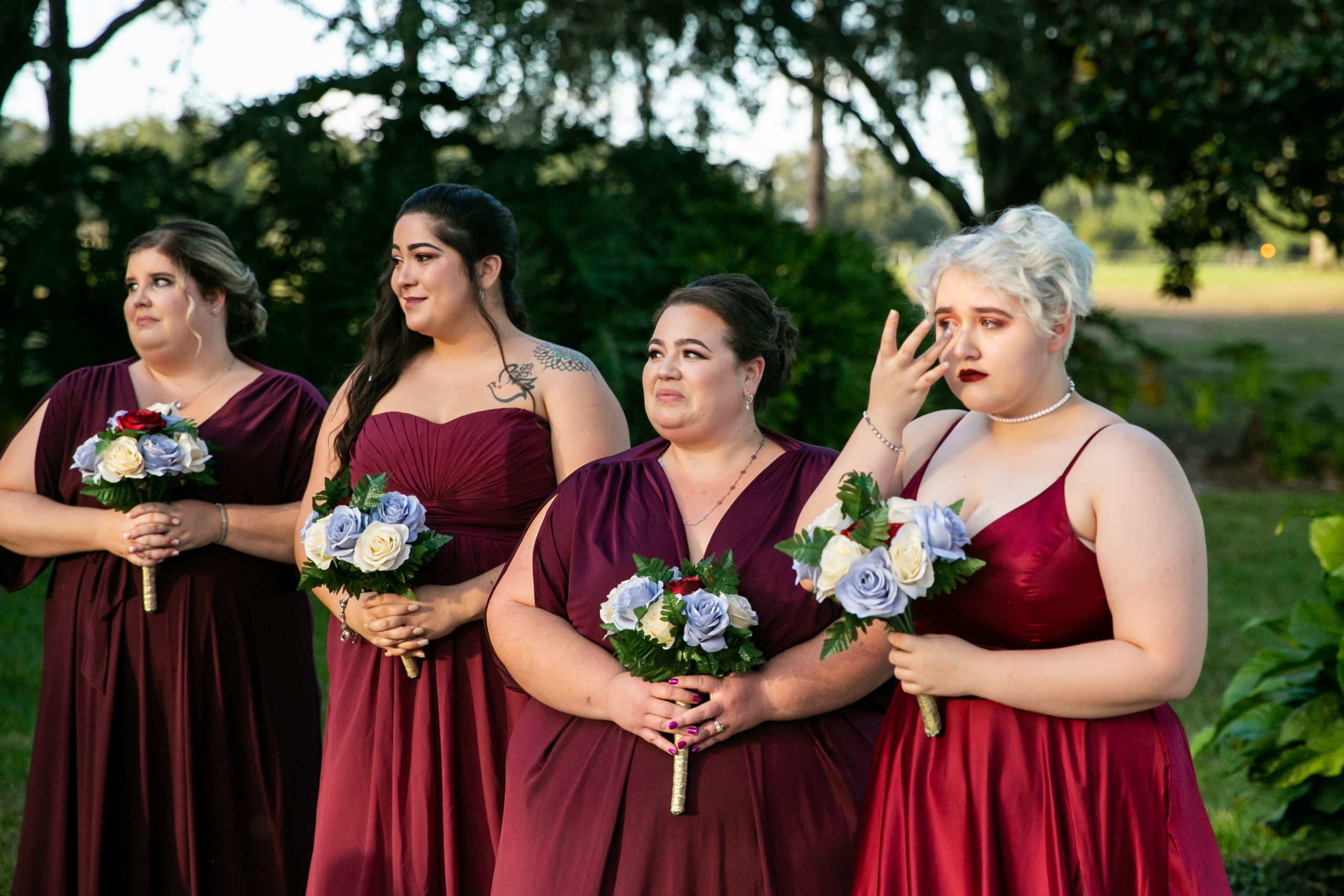 bridesmaids in burgundy for vineyard inspired wedding