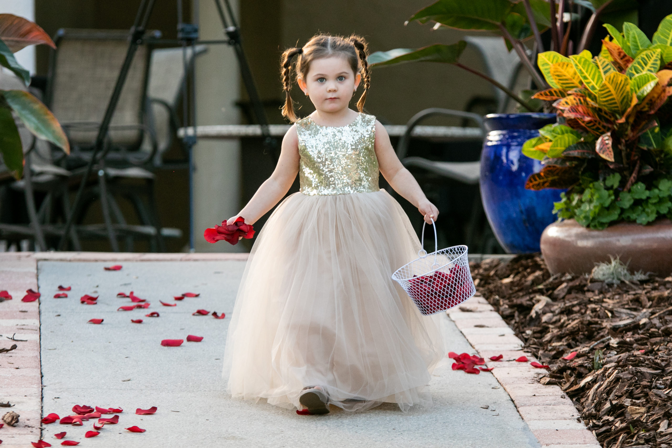 second flower girl dropping rose petals