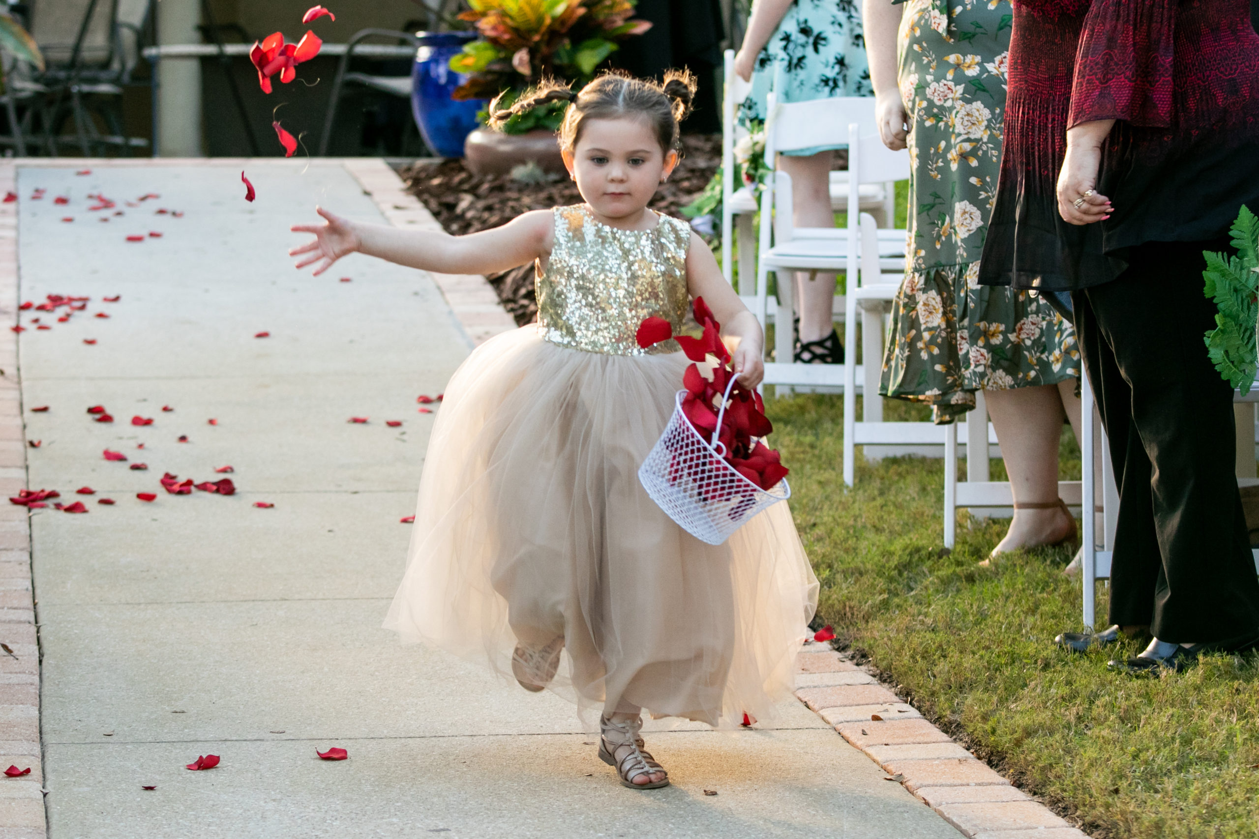 young flower girl skipping down the aisle