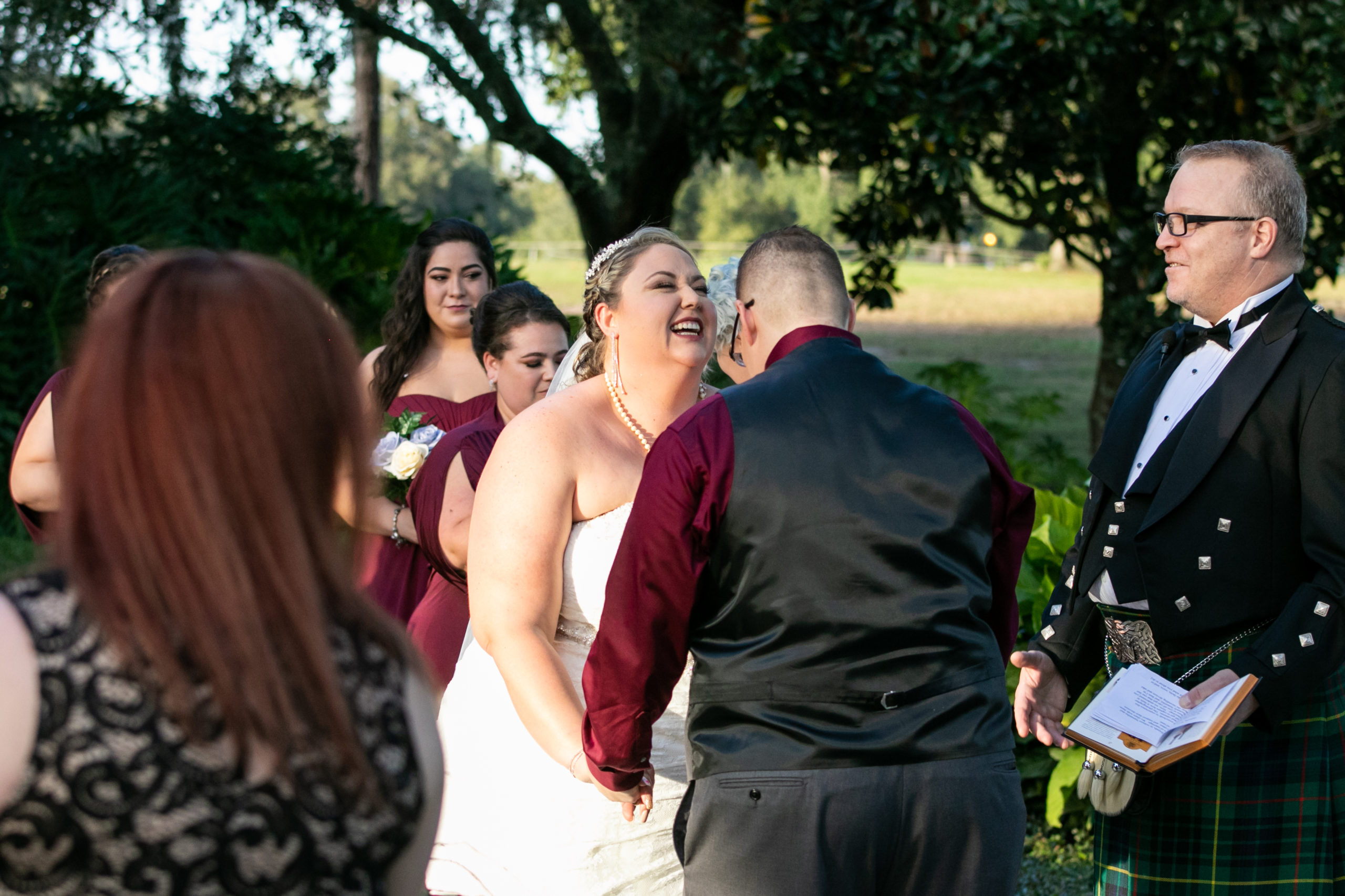 brides laughing and holding hands at wedding ceremony
