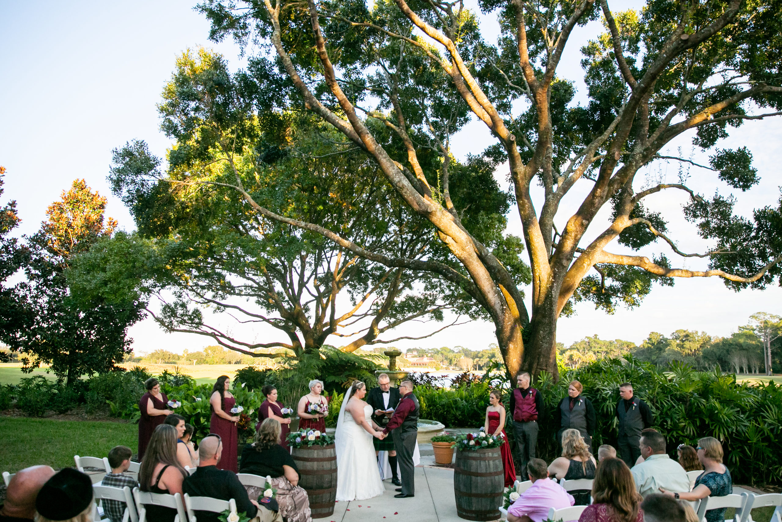 vineyard inspired wedding ceremony with wine barrels