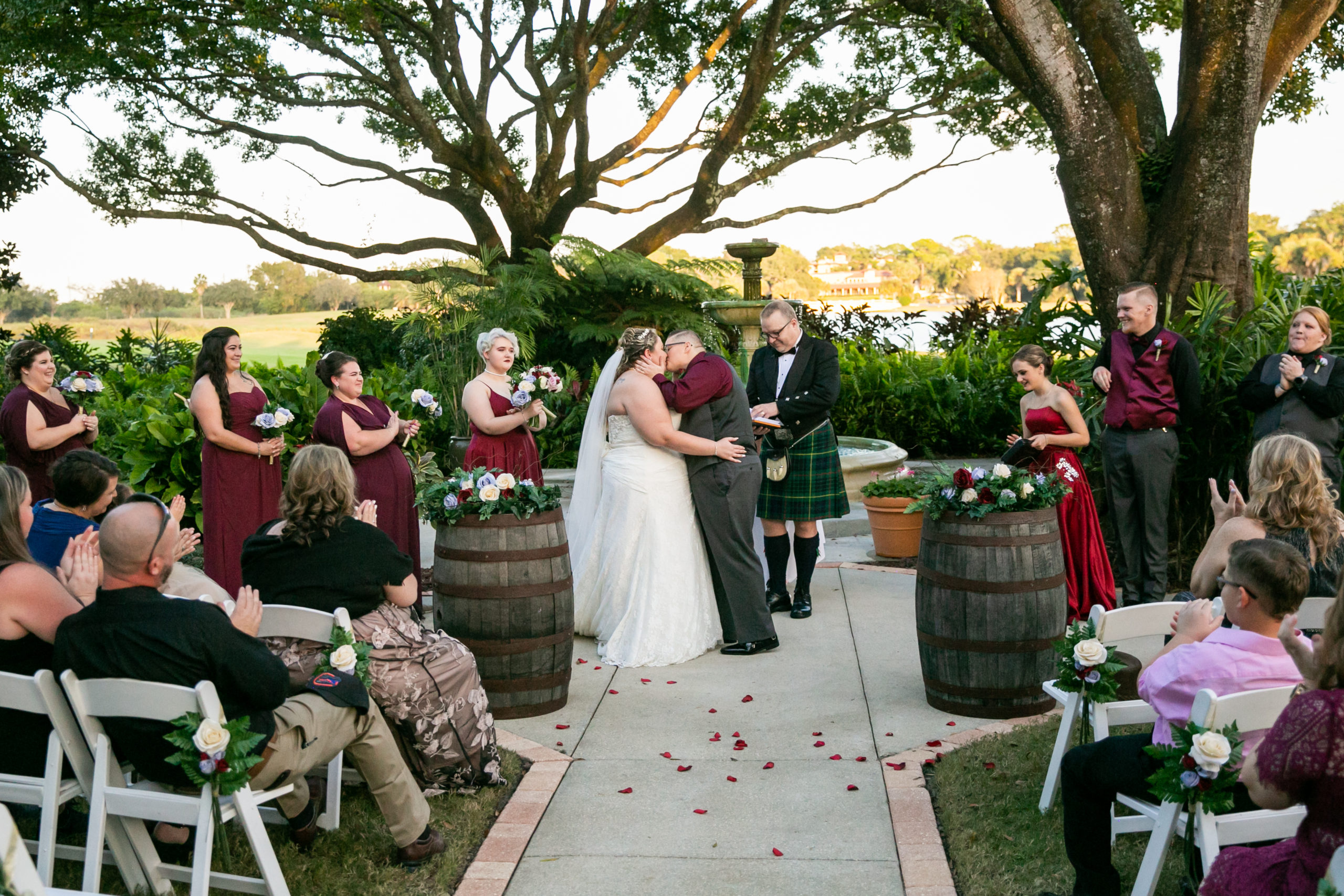 Brides kissing at the end of the vineyard inspired ceremony