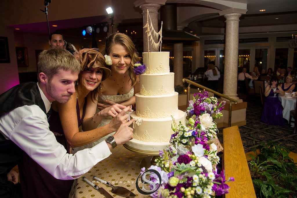 wedding guests sneaking cake early