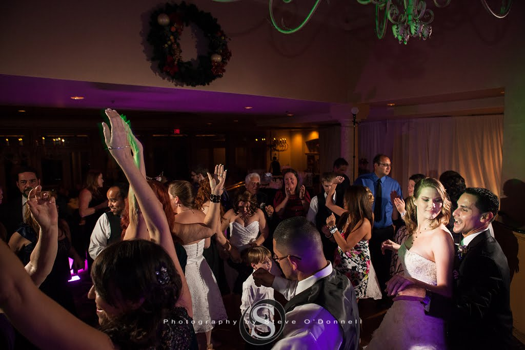 wedding reception dancing with purple uplights