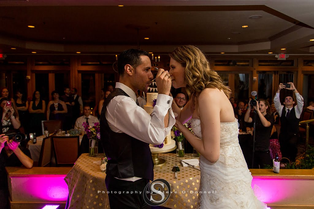 bride and groom feeding each other
