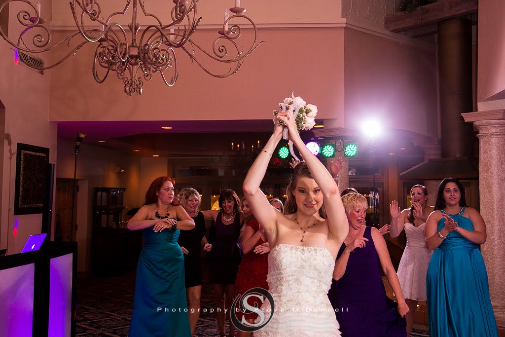 bride tossing her bouquet to bridesmaids