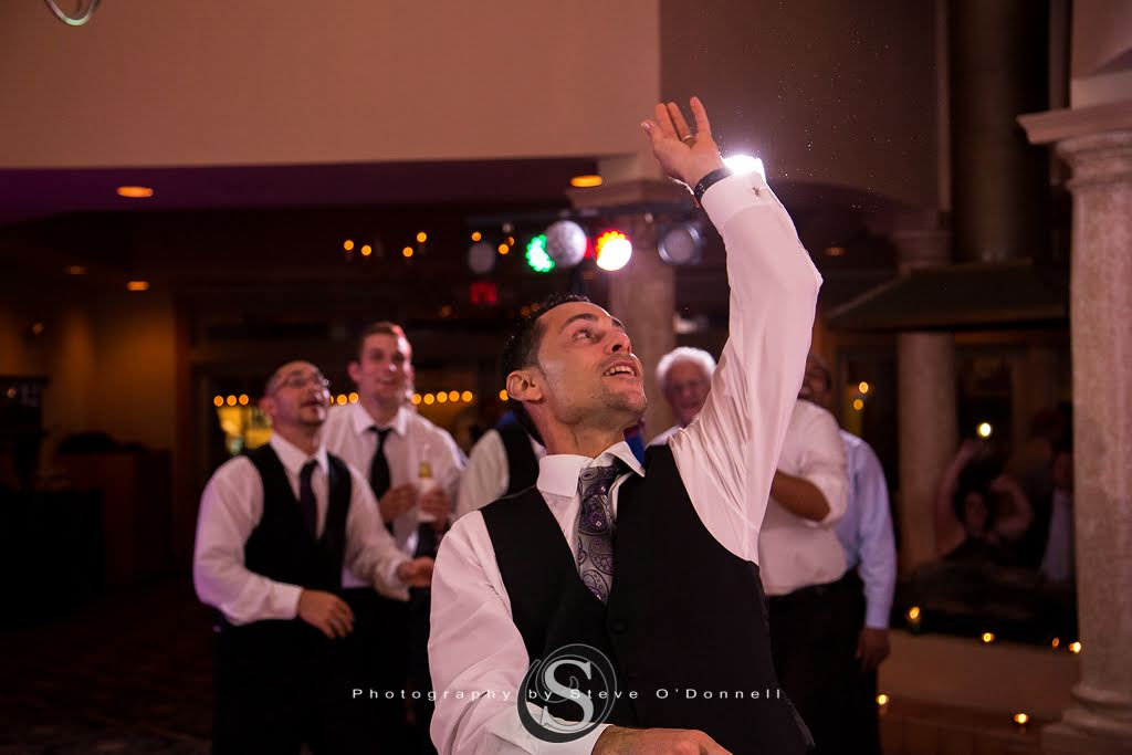 groom throwing brides garter