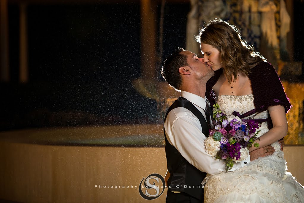 Groom Kissing Bride on Fountain at night