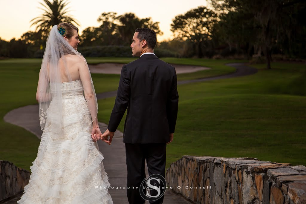 bride and groom portrait on Florida golf course bridge