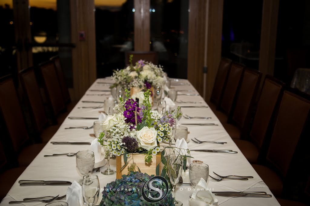 White Wedding Table with Purple and White Flowers