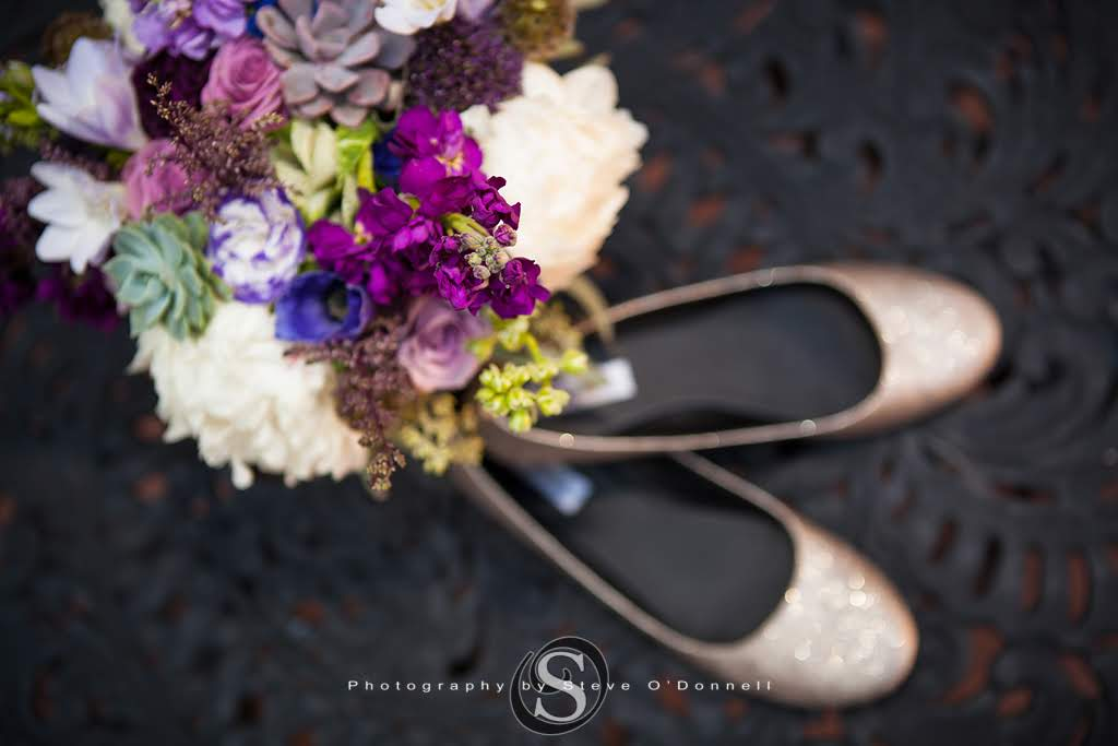 Purple peacock floral bouquet with rose gold glitter wedding flats