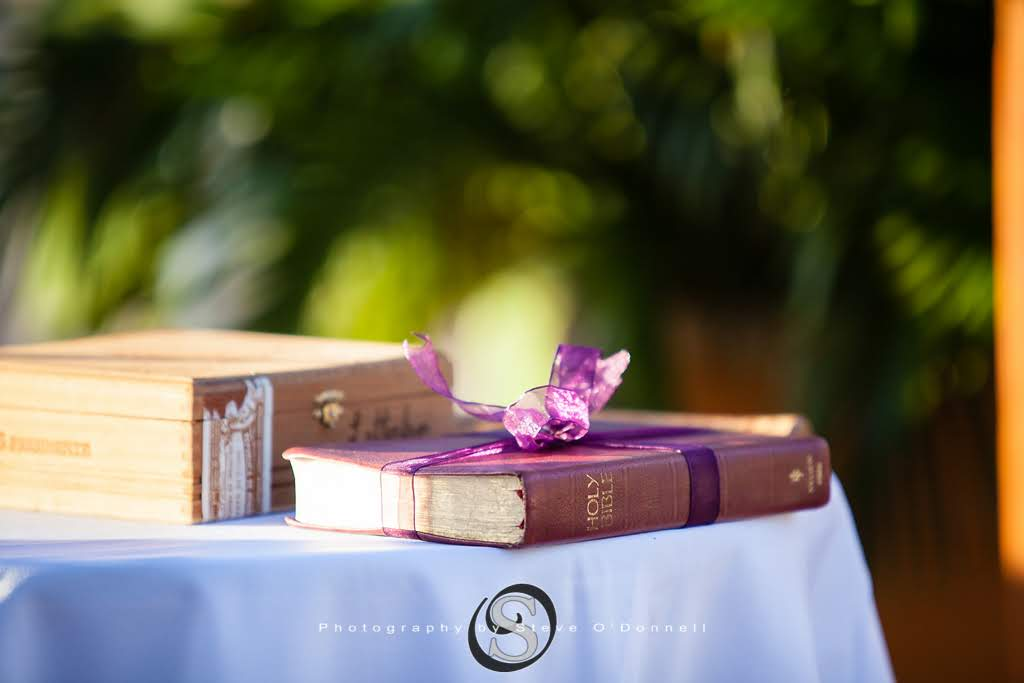 Bible wrapped in purple ribbon with letter box