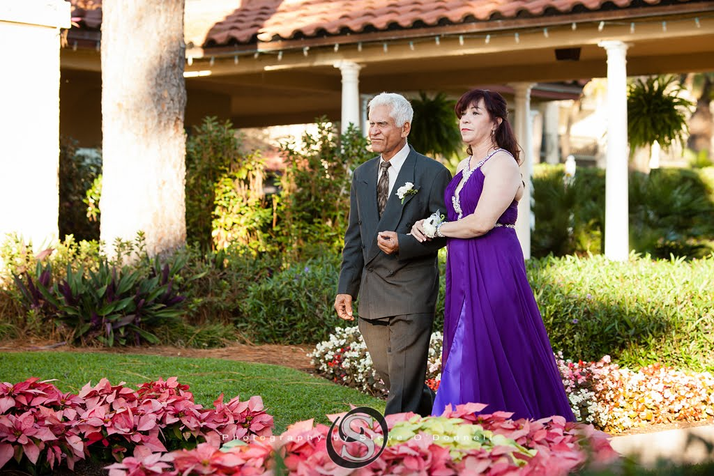 mother of groom being escorted down the aisle in purple wedding dress