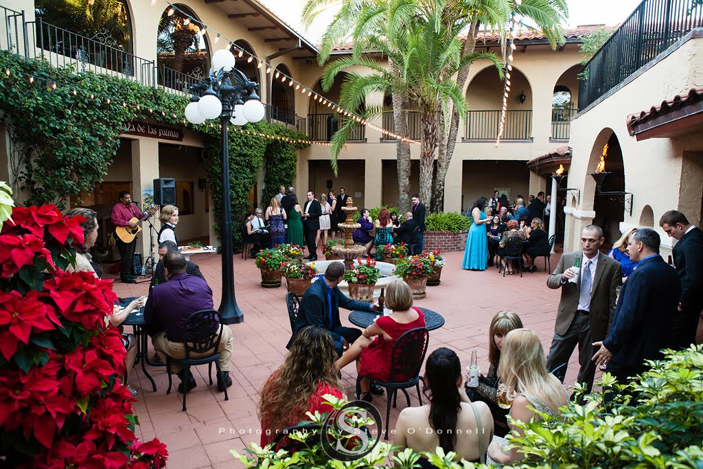Guests in courtyard enjoying cocktail hour