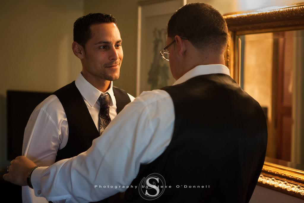 Groom talking to groomsmen