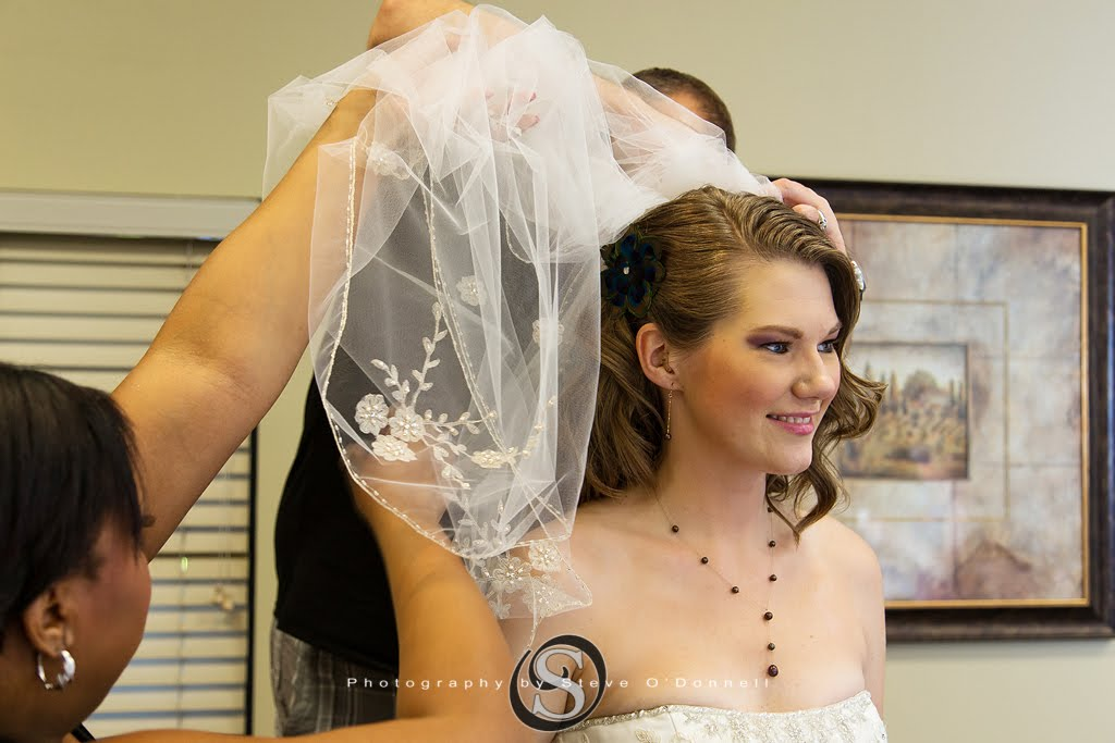 beautiful bride getting her veil put on