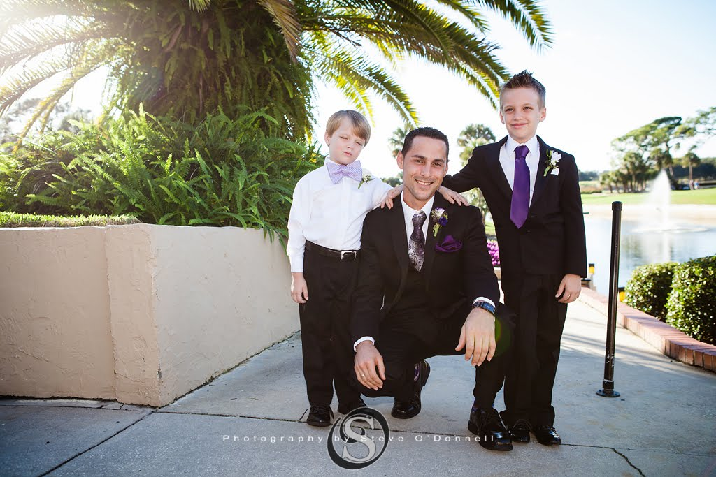 Groom with ring bearers for purple peacock wedding