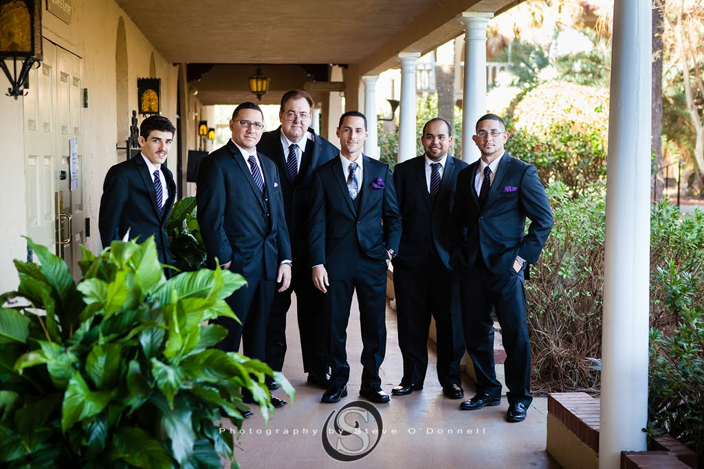 Groomsmen with purple ties at Florida wedding