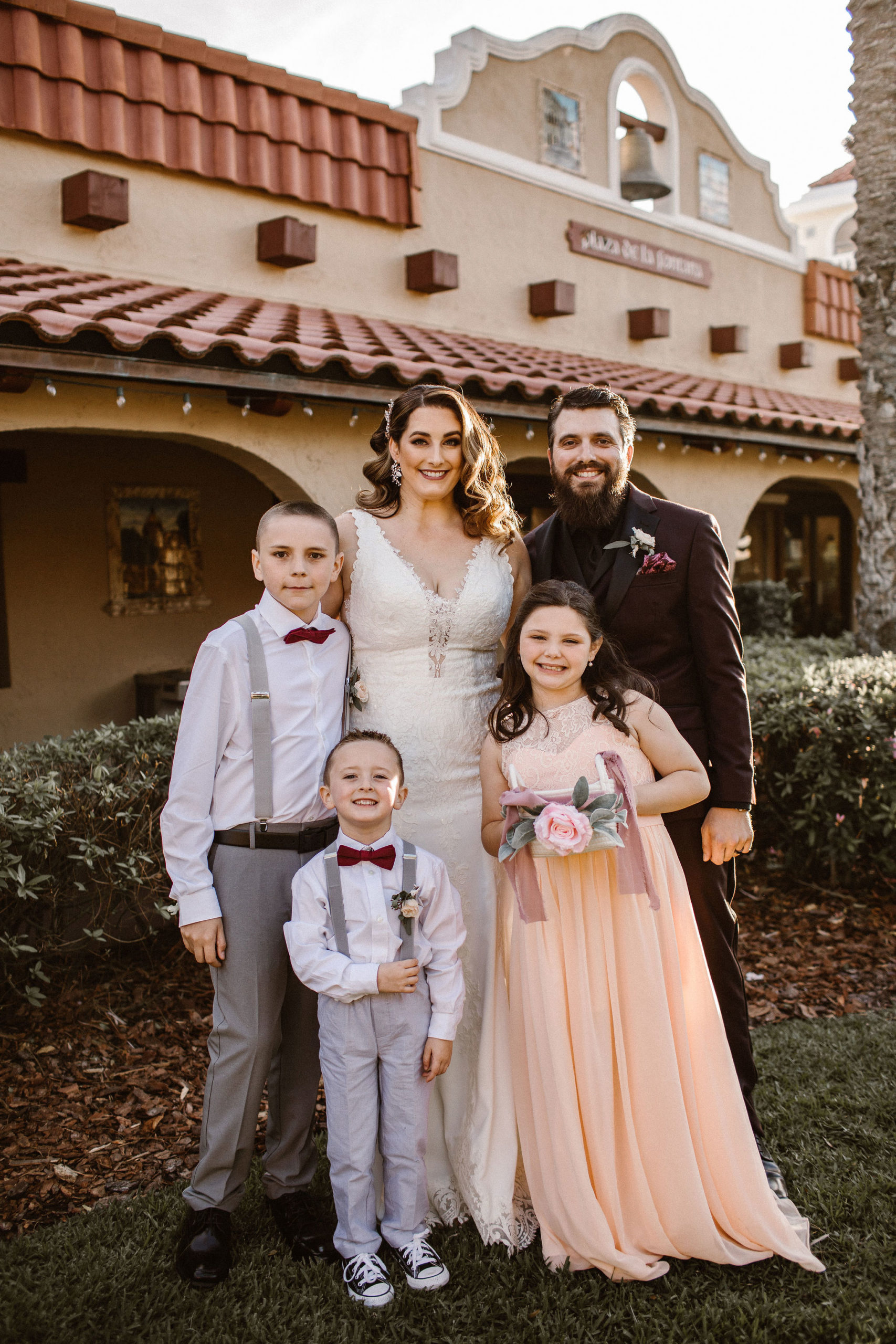 bride and groom with flower girl and ring bearers