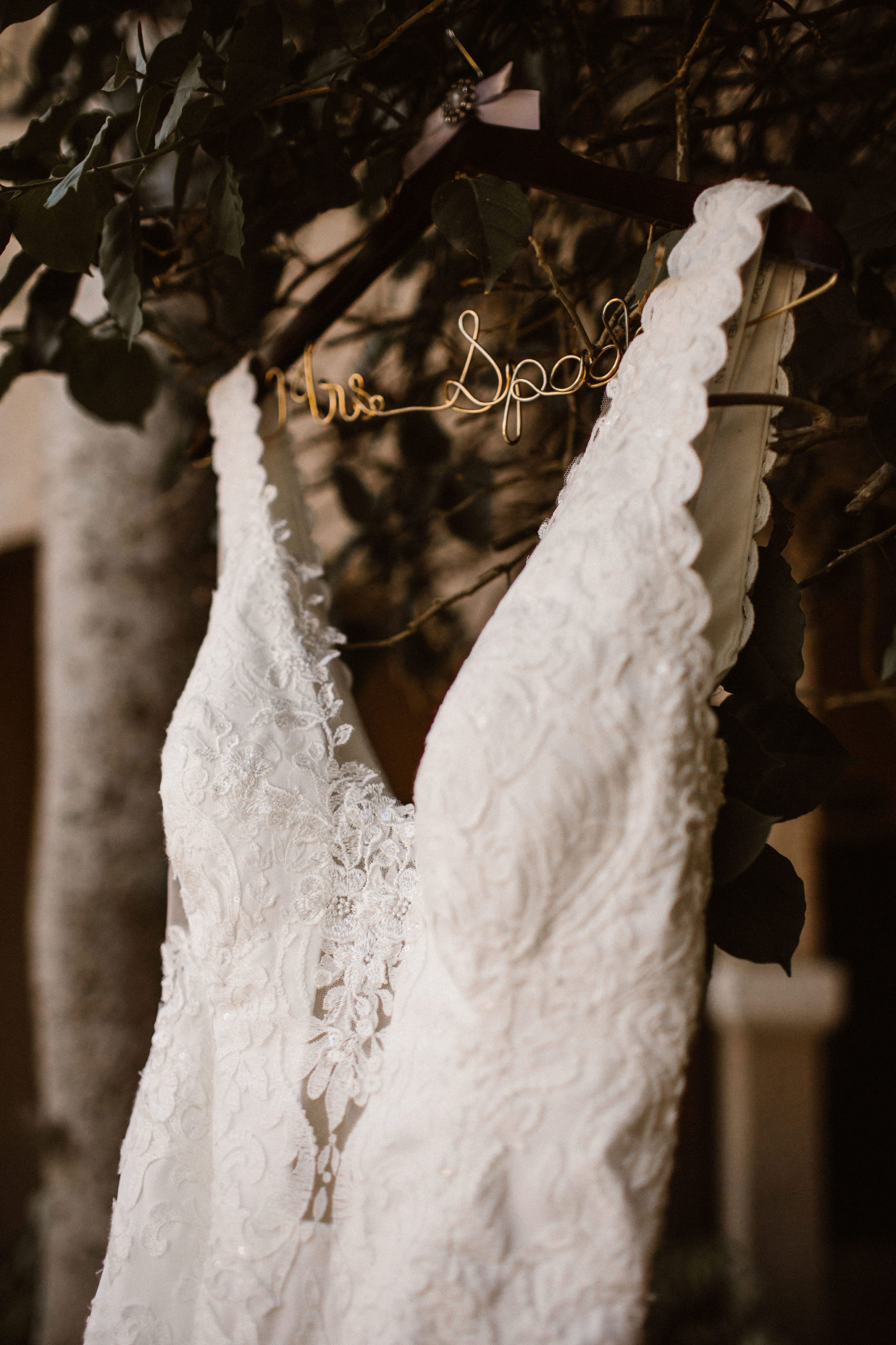 brides dress hanging on custom hanger