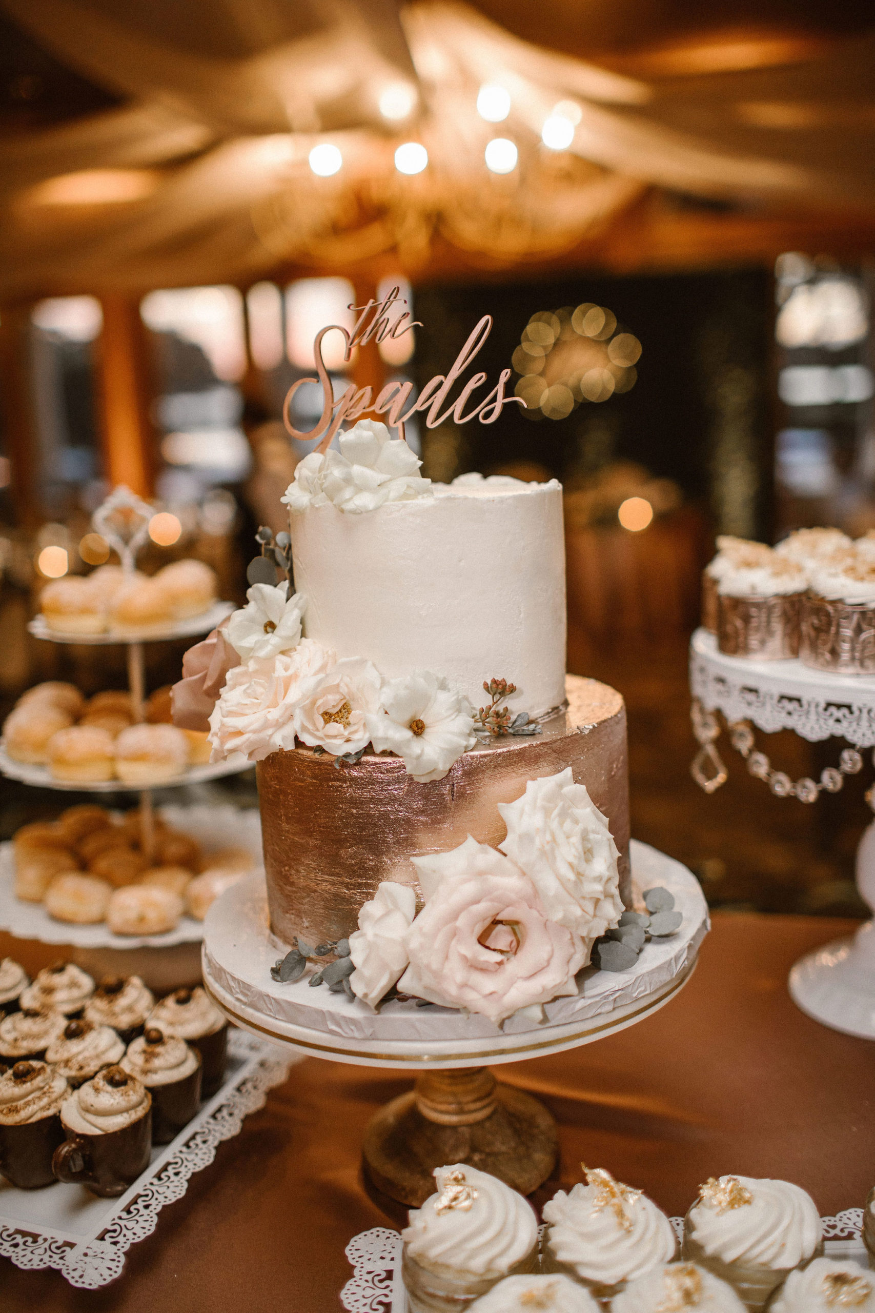 rose gold wedding cake with mauve flower