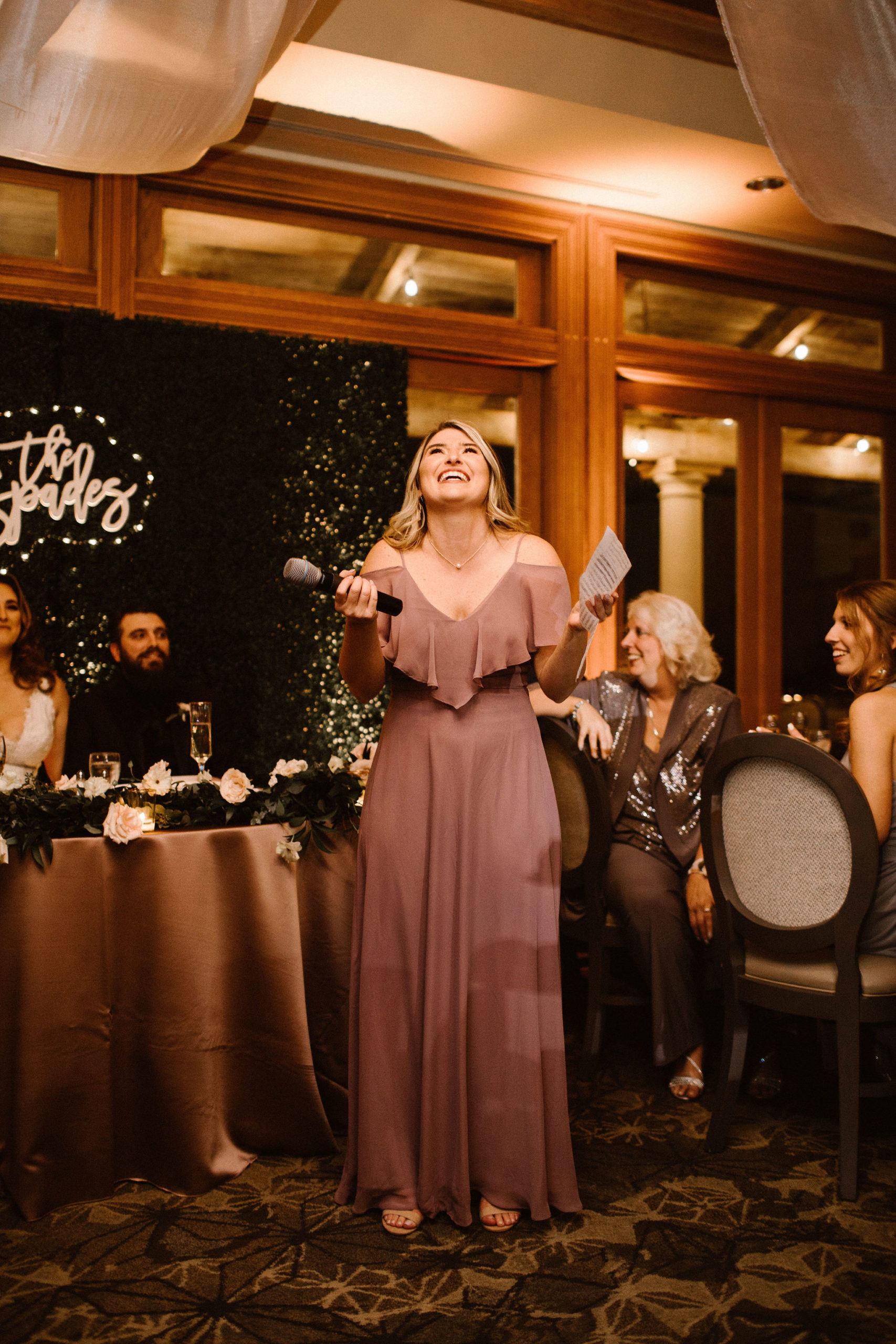 Bridesmaid giving speech to bride and groom
